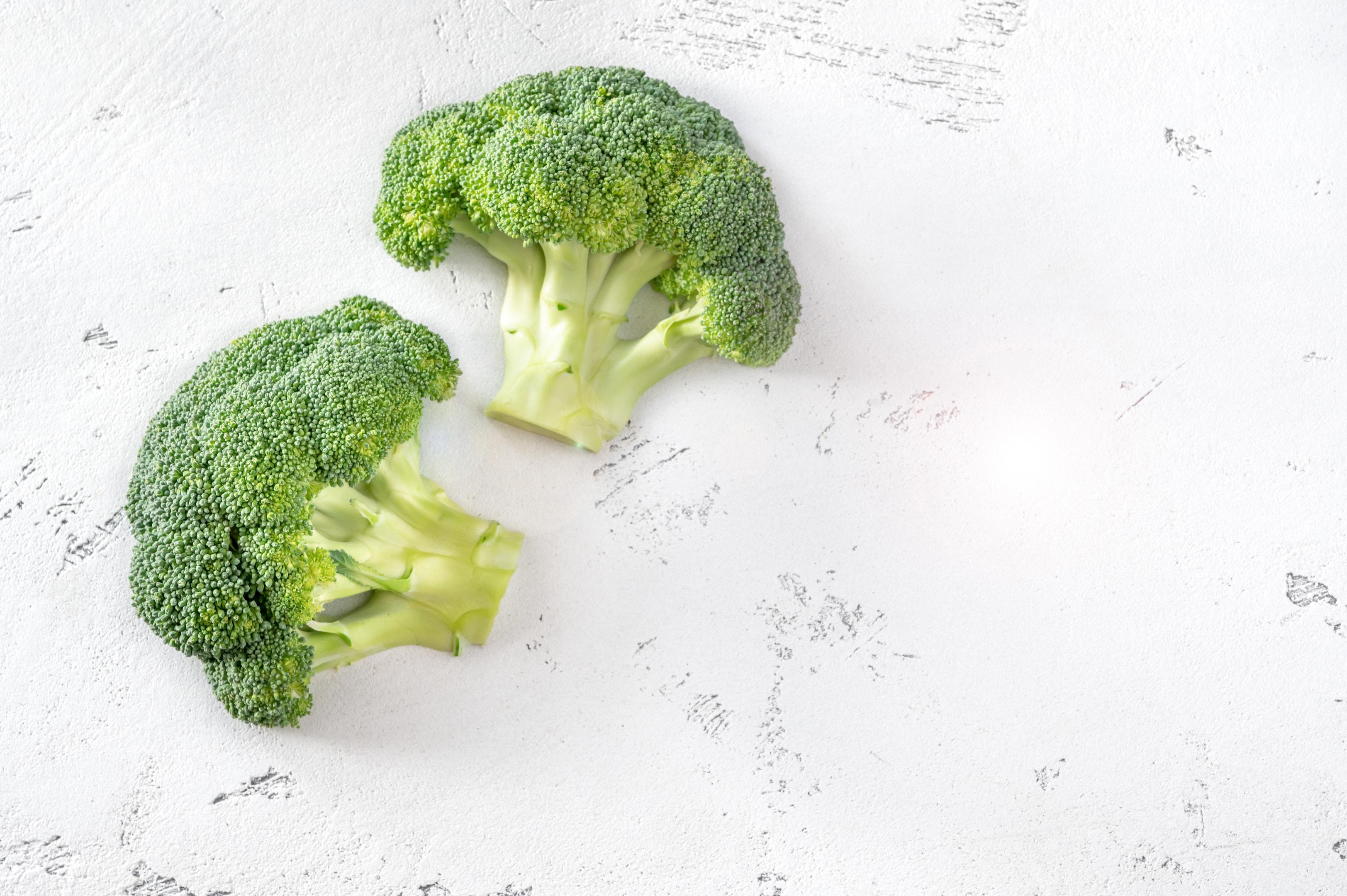 Fresh Broccoli on White Wooden Background