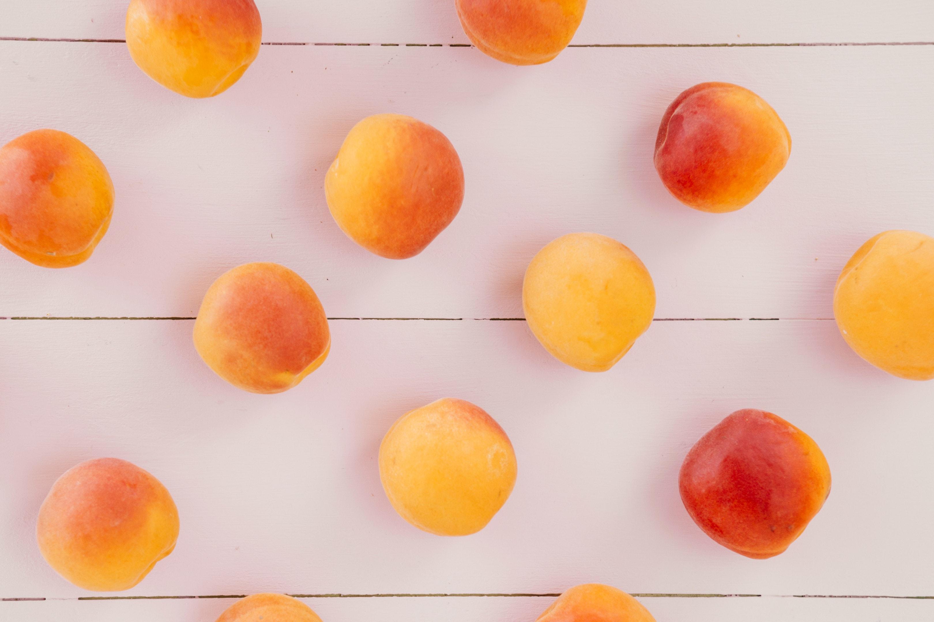 Fresh Peach Fruits on Wooden Desk