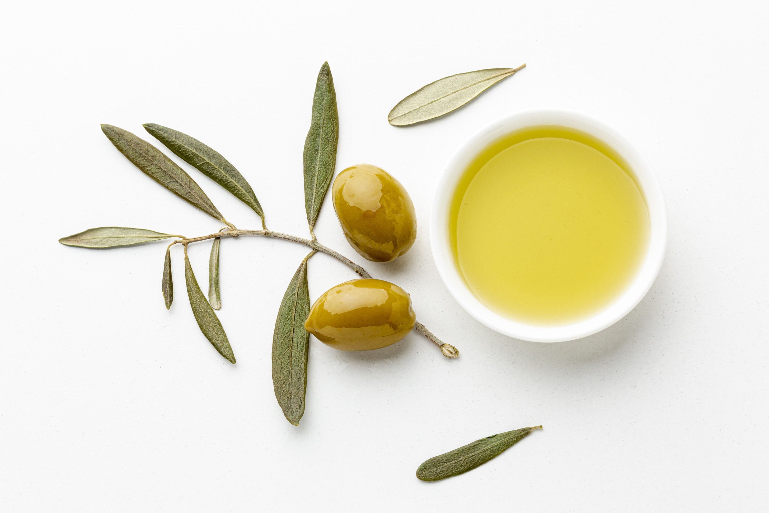 Olive Oil With Olive Tree Leaves and Yellow Olives