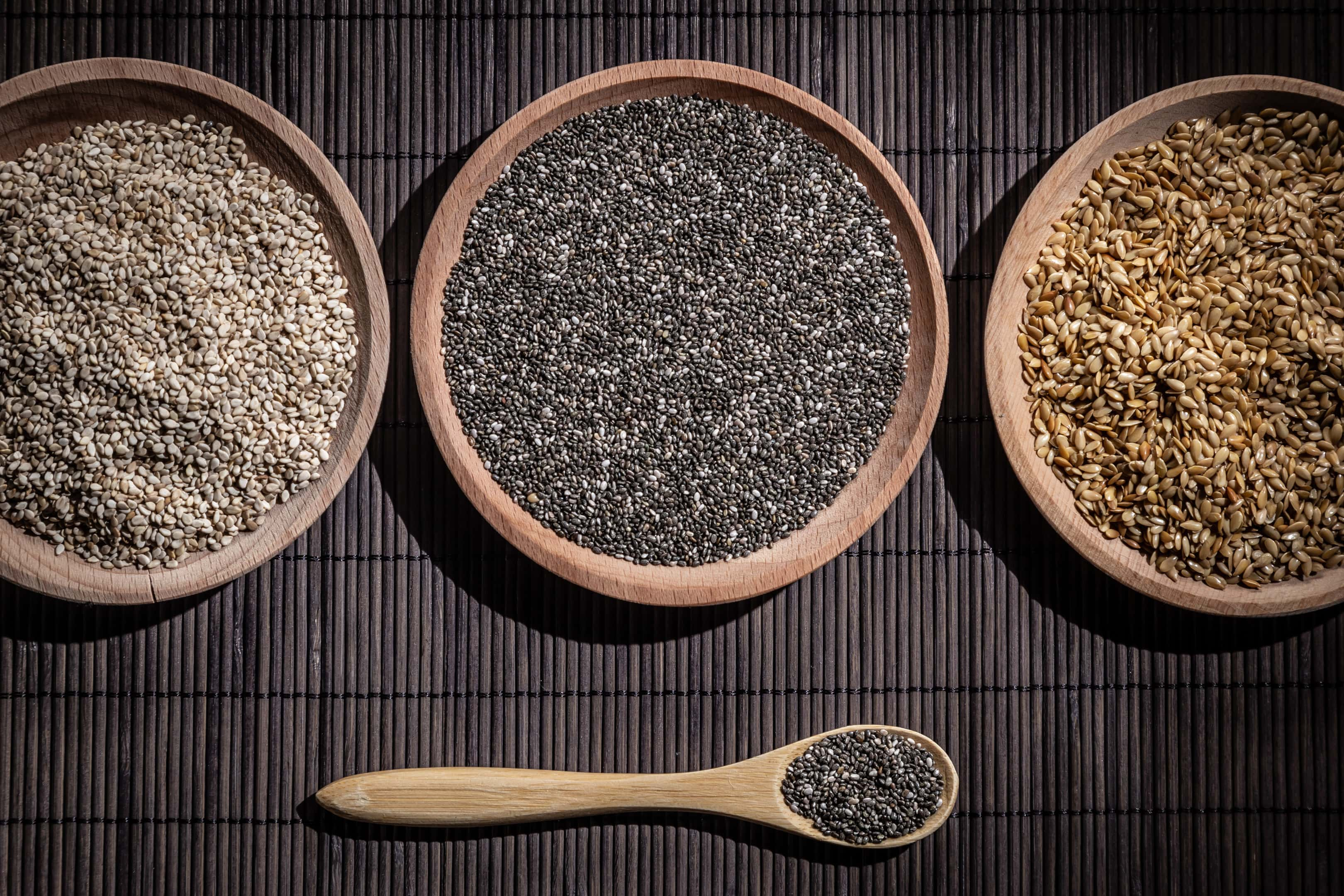 Sesame Chia and Flax Seeds in Wooden Dishes