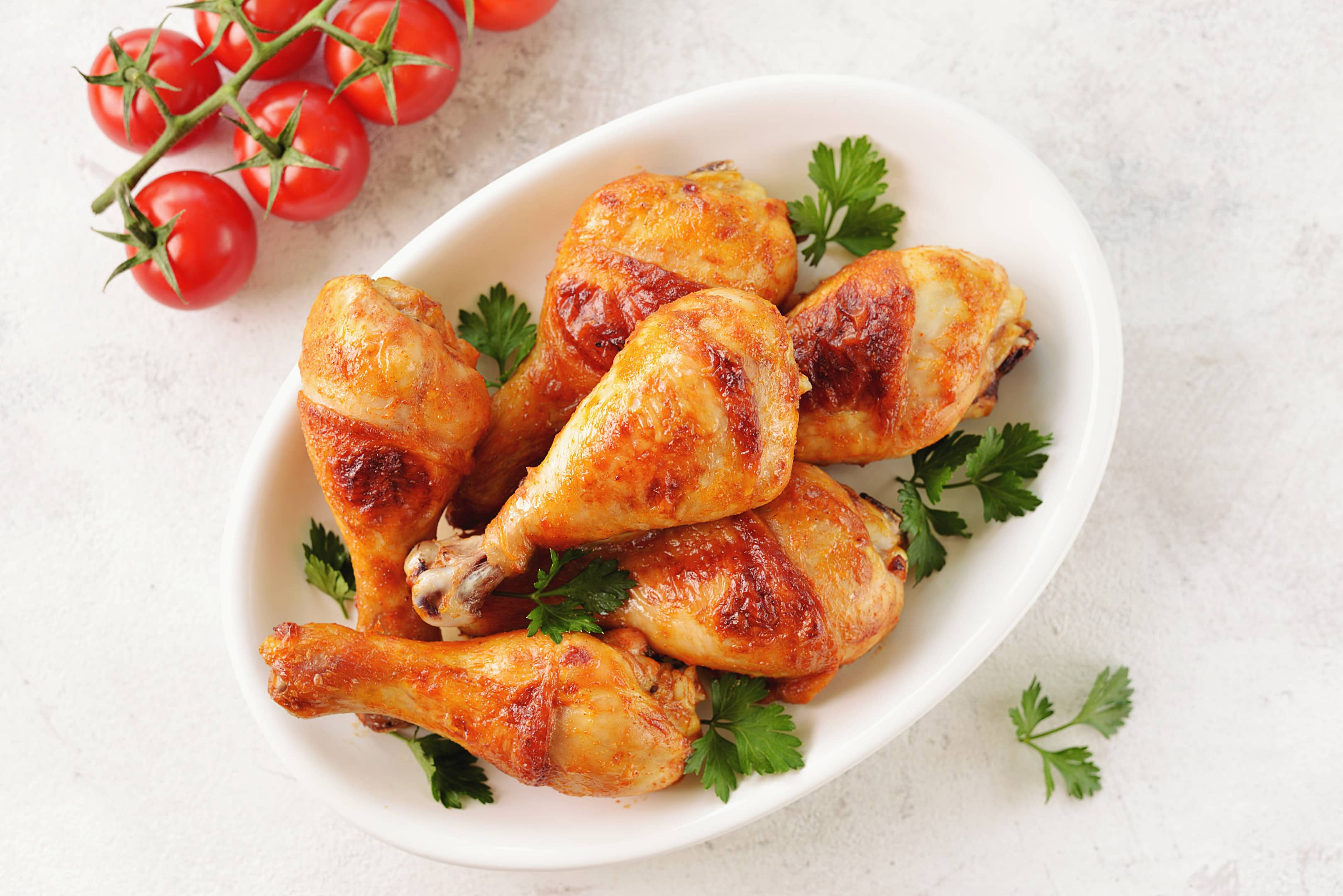 Chicken drumsticks baked with tomato sauce soy sauce and olive oil