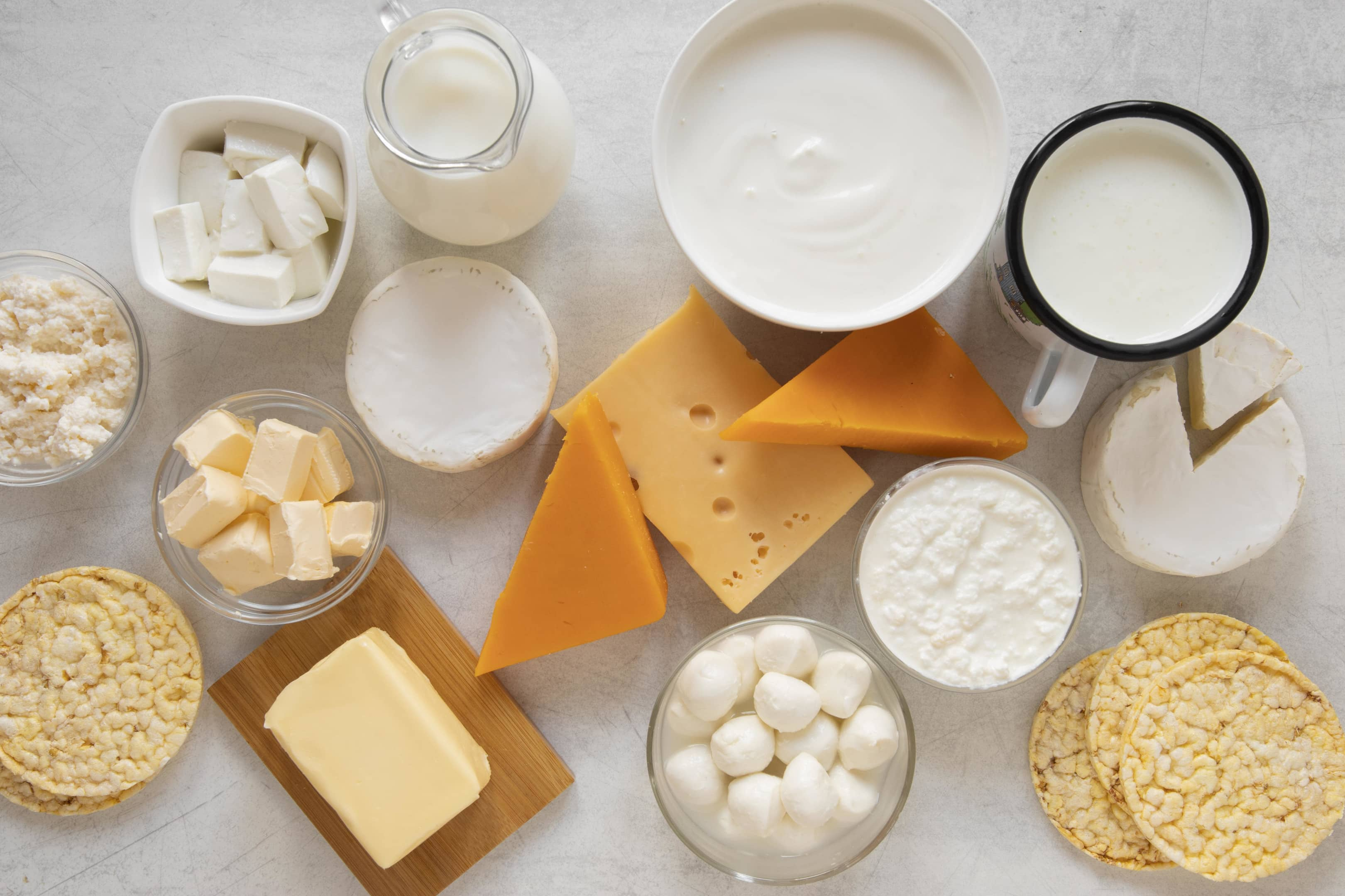 Dairy products assortment on white table