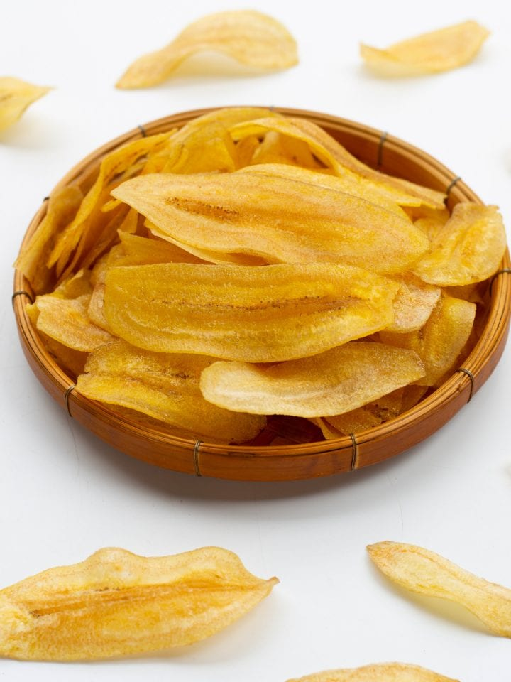 Dehydrated banana chips on white background