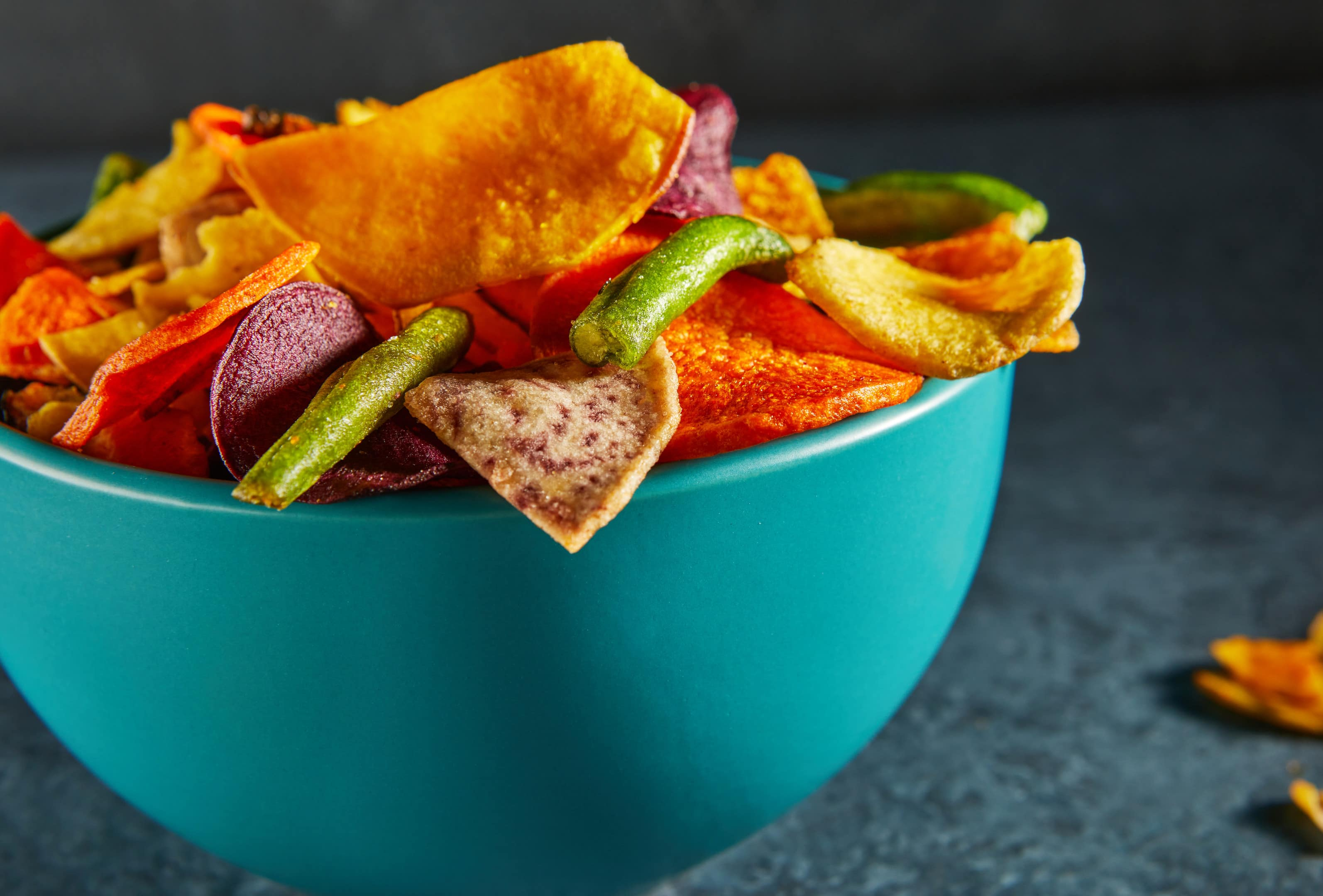 Dehydrated vegetable chips in blue bowl