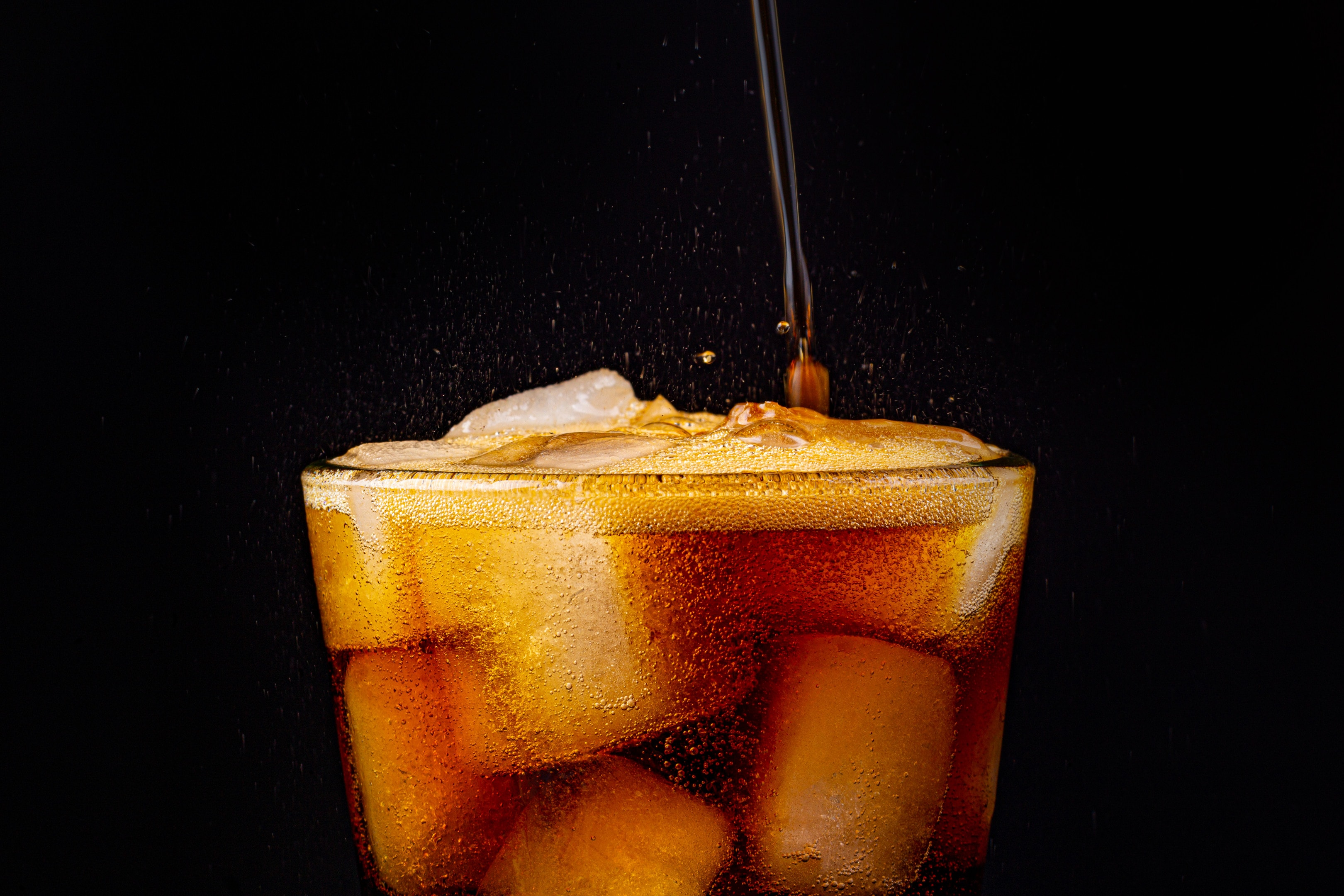 Fizz sparkling cola soda with ice cubes