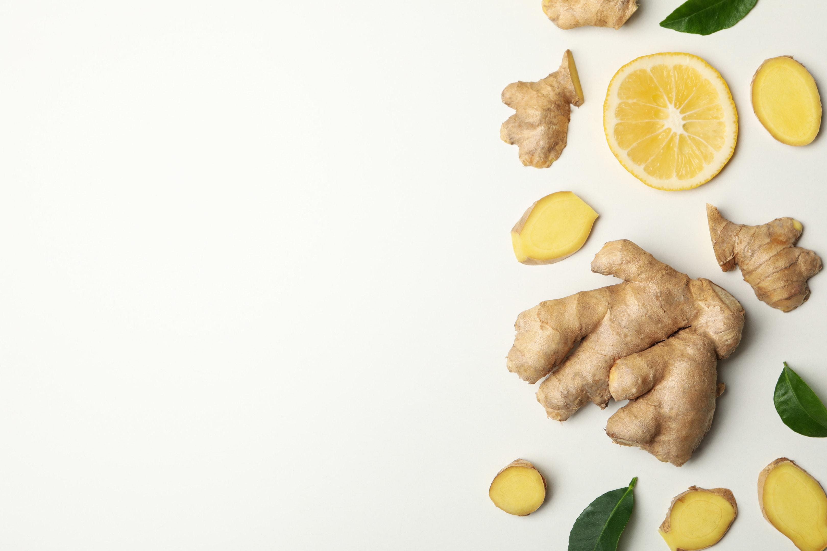 Fresh ginger and lemon on white background