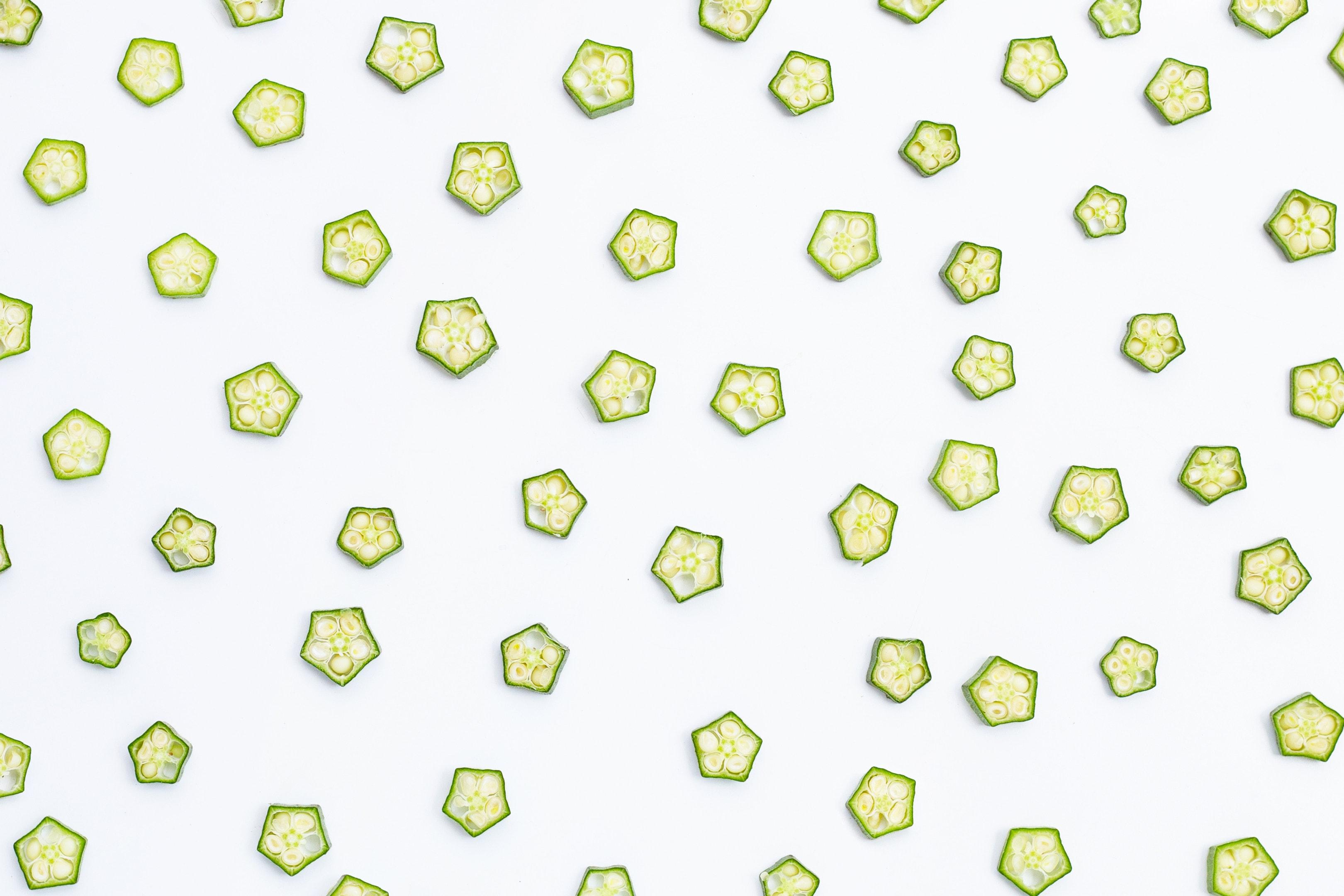 Fresh okra slices on white background