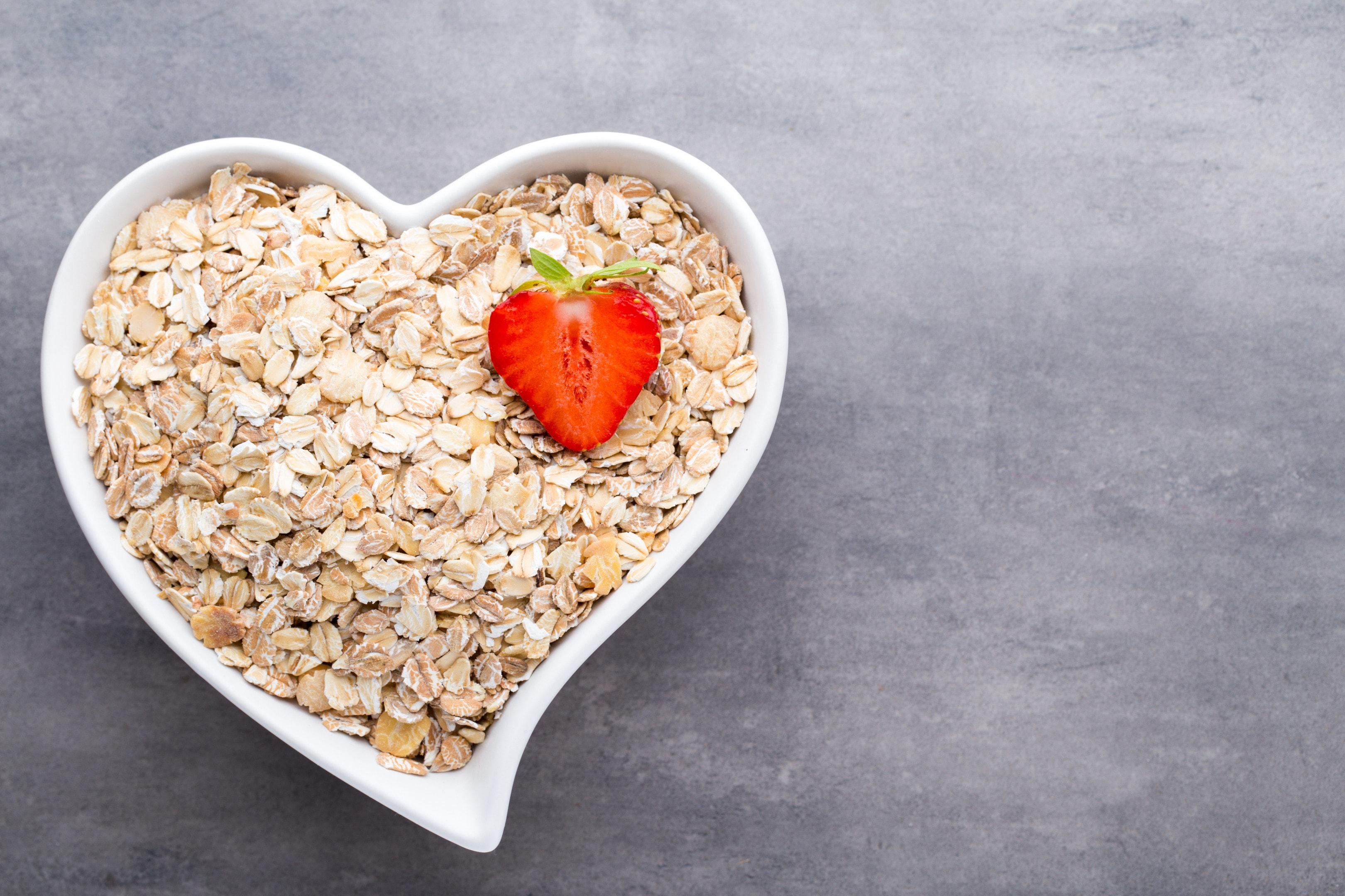Fried oat flakes in heart shaped bowl