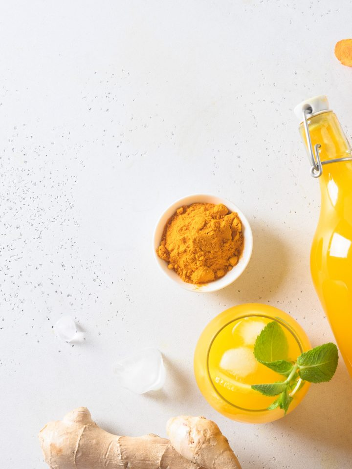 Jamu Indonesian herbal beverage with turmeric and ginger on white background