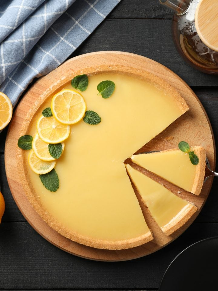 Lemon tart on dark wooden background