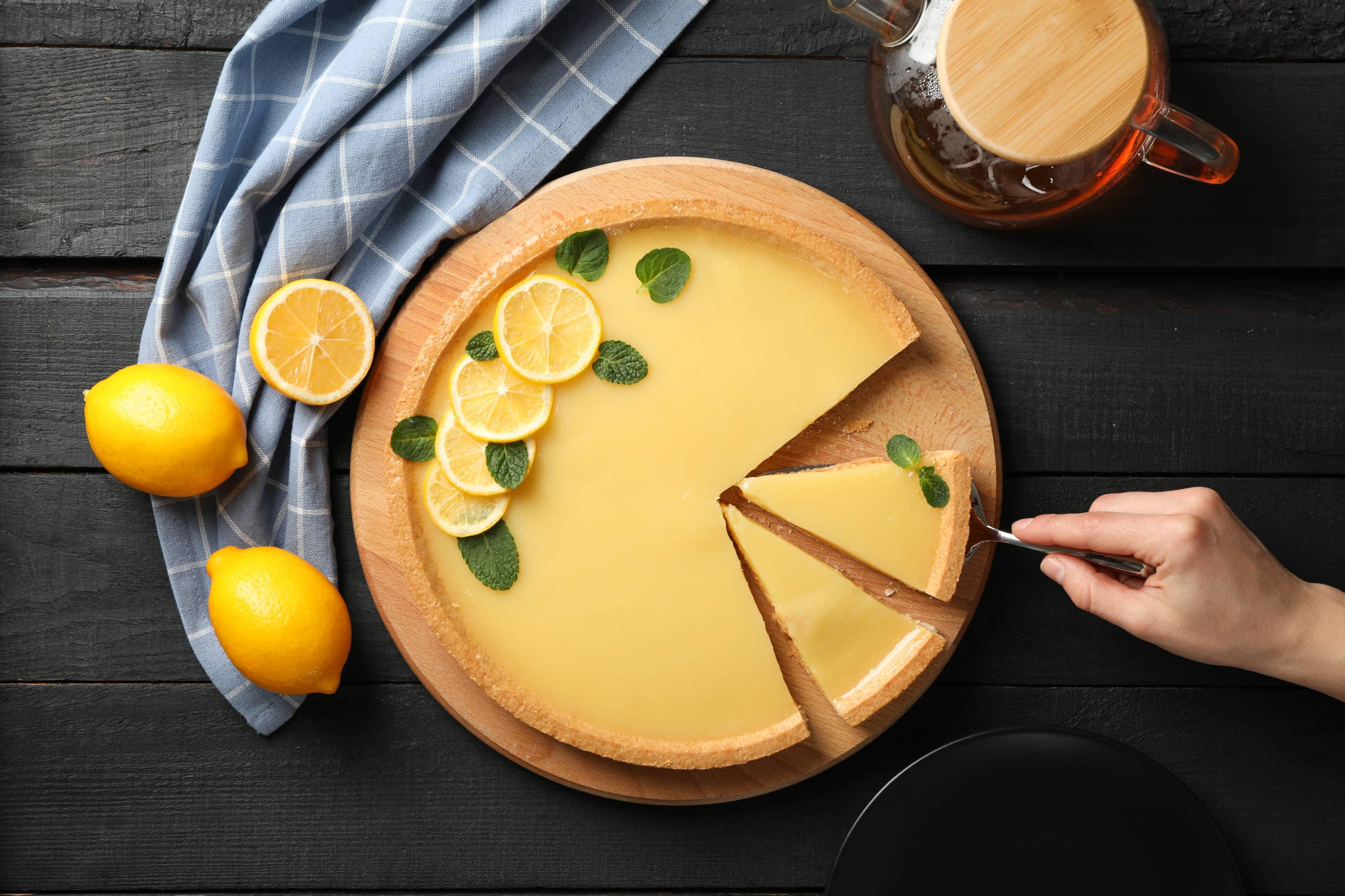 Lemon tart on dark wooden background