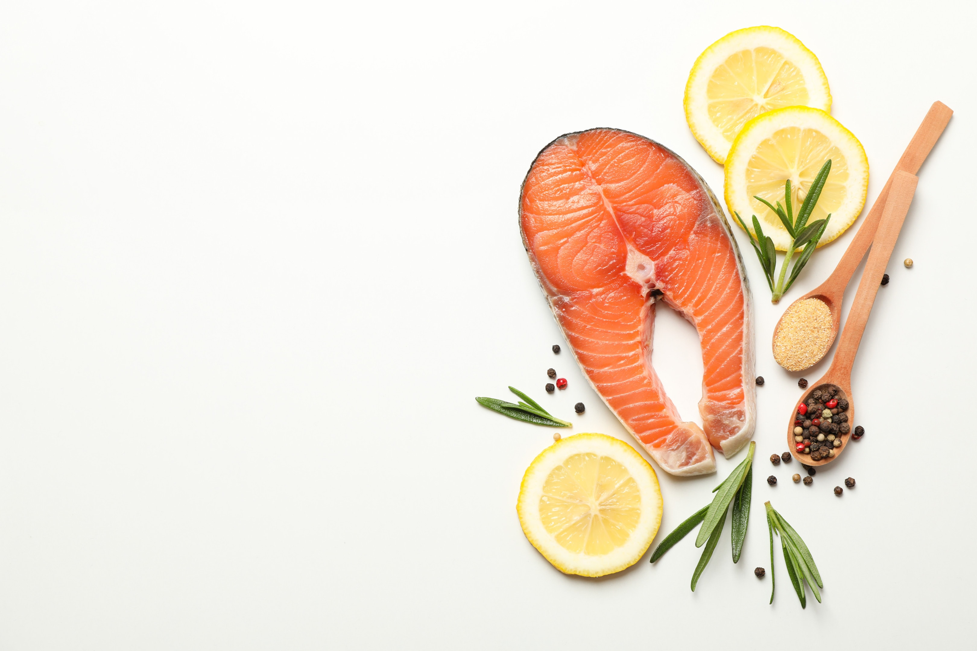 Salmon and spices on white background