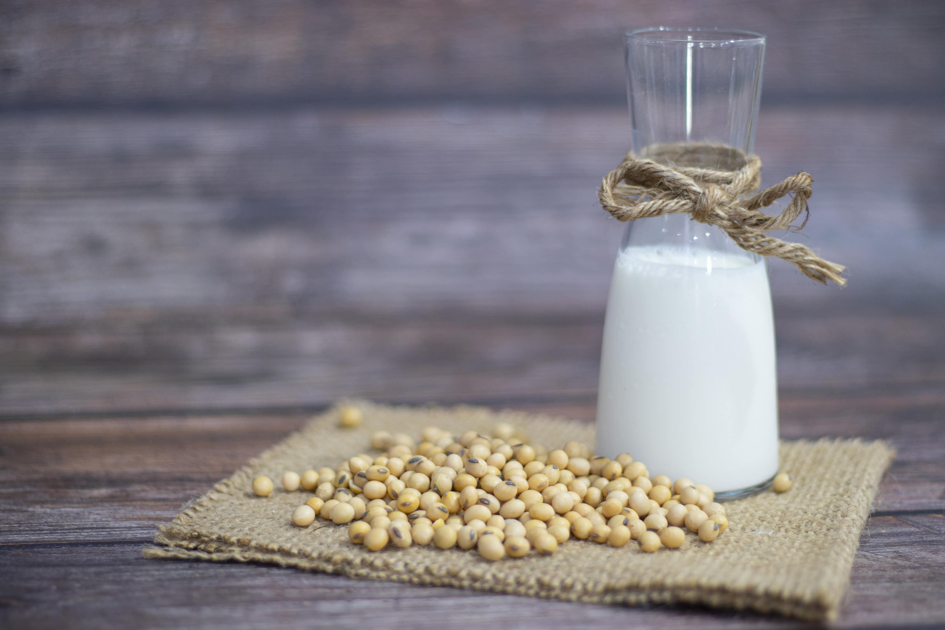Soy products soy beans soy milk on wooden table