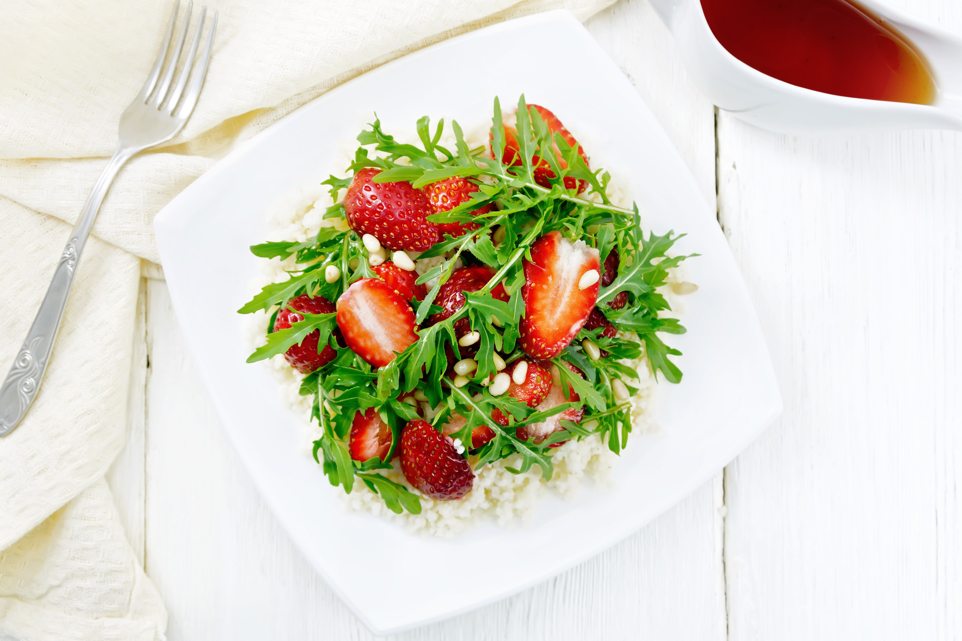 Strawberry couscous with arugula salad dressed with fruit vinegar