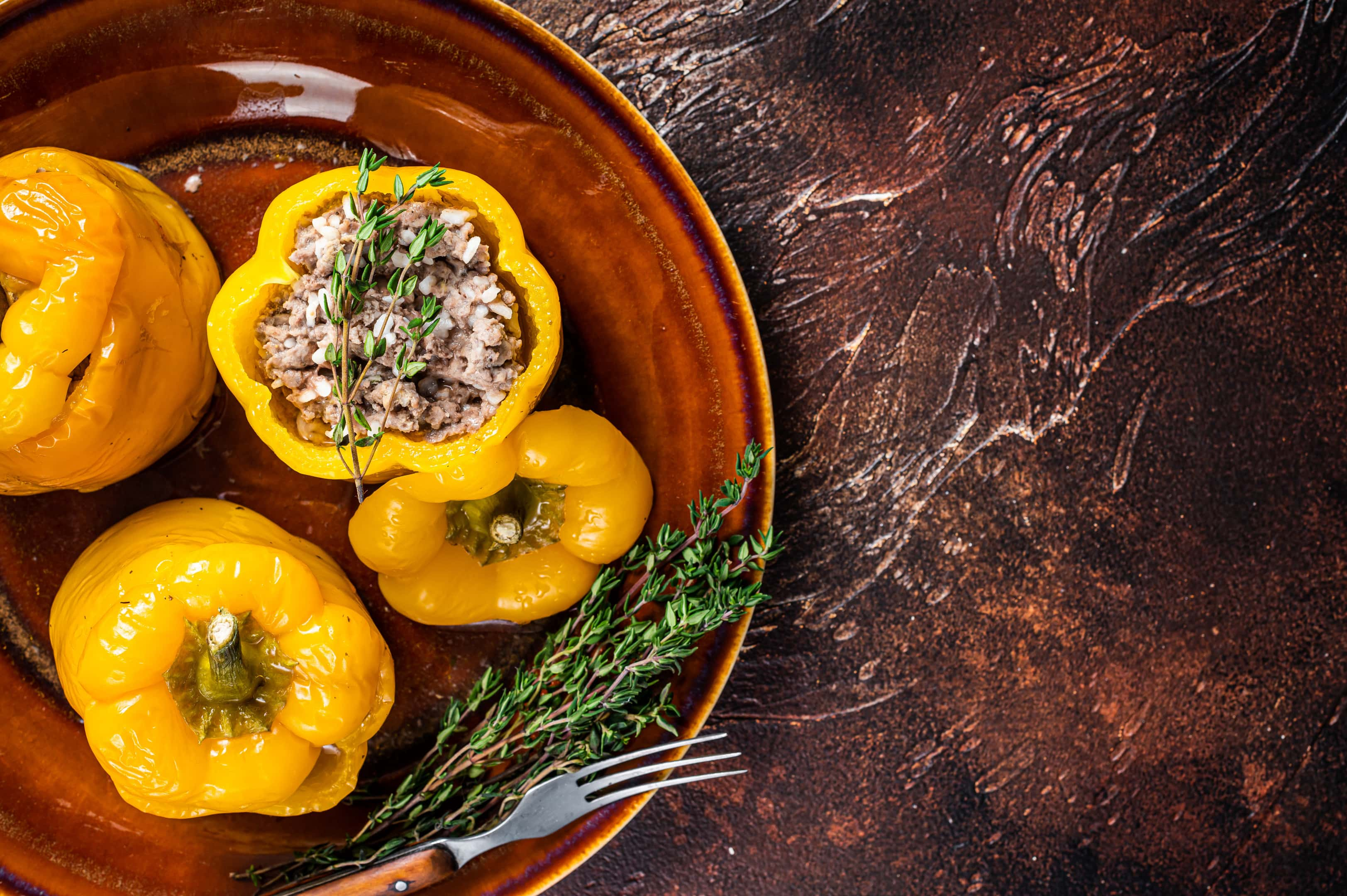 Baked sweet bell pepper stuffed with beef meat rice and vegetables