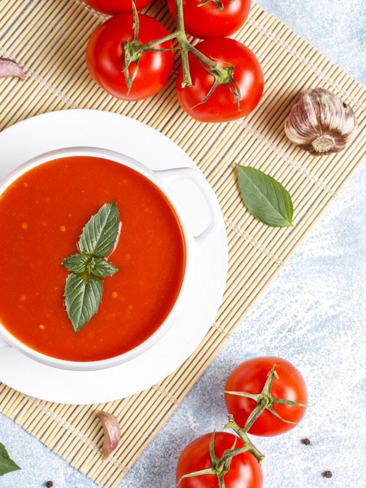Bowl of tomato soup with basil