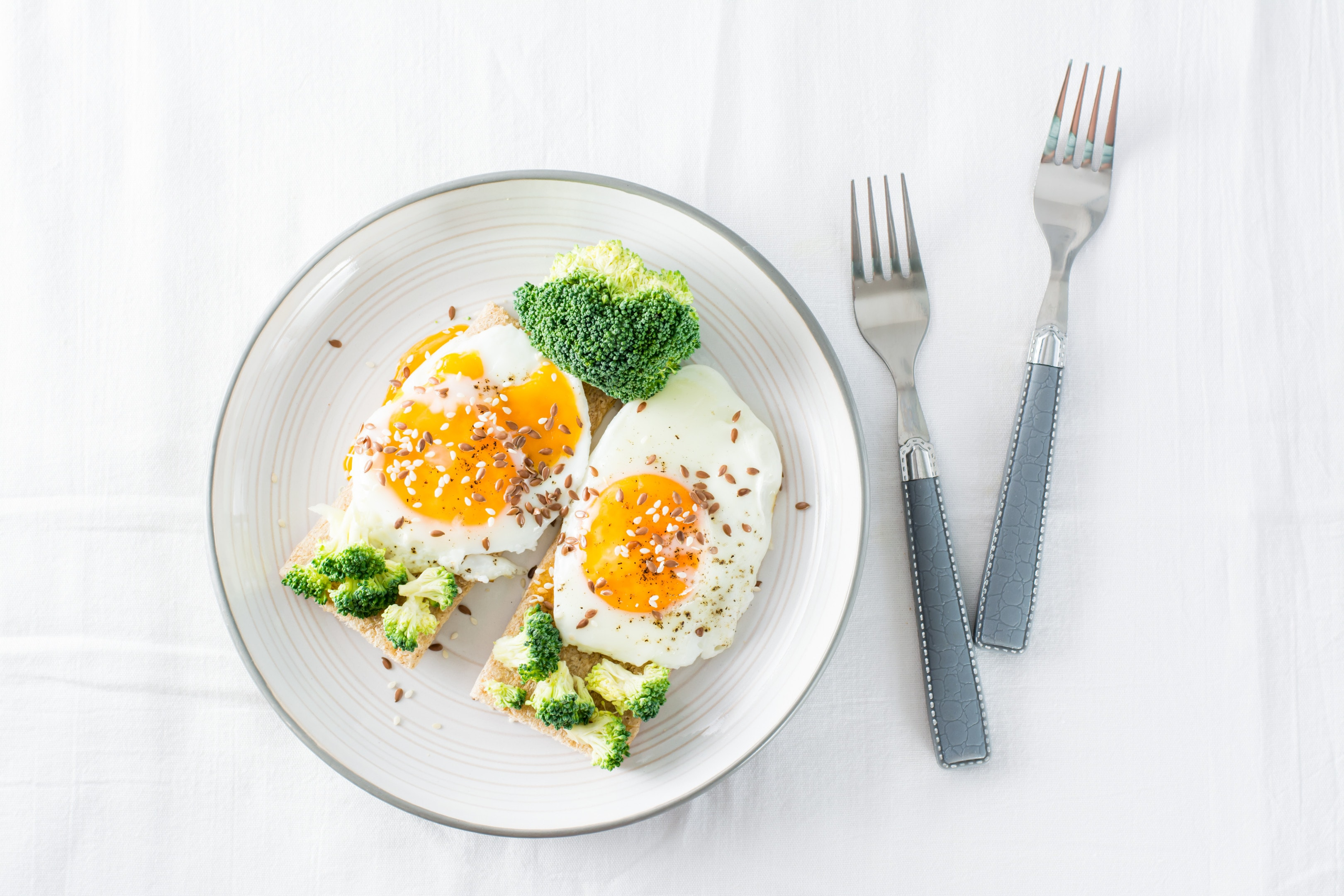 Bruschetta with eggs broccoli sesame seeds and flaxseed