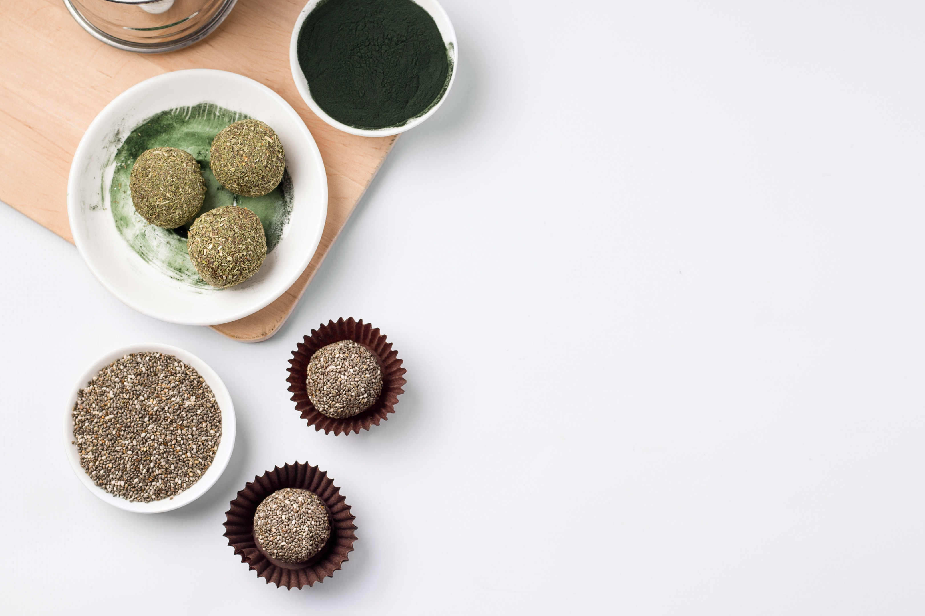 Energy balls of dried fruits with spirulina and chia seeds