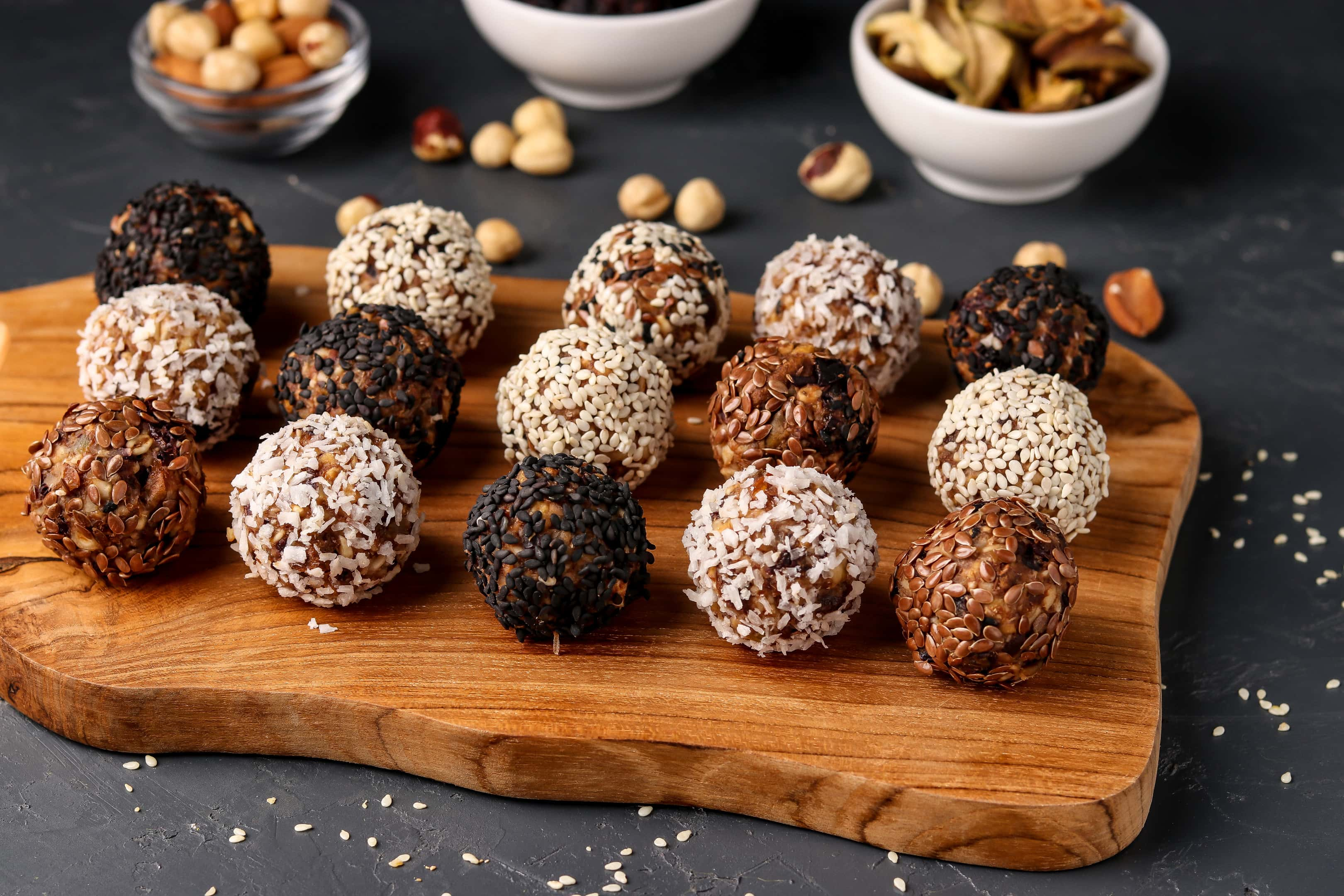 Energy balls with nuts oatmeal and dried fruit on wooden board