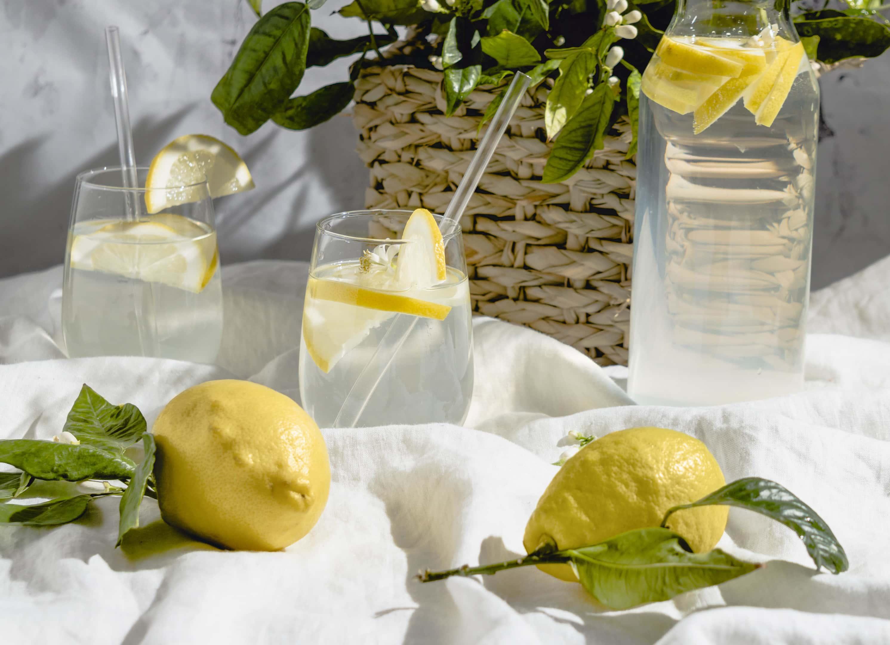 Fresh lemonade with ripe lemons