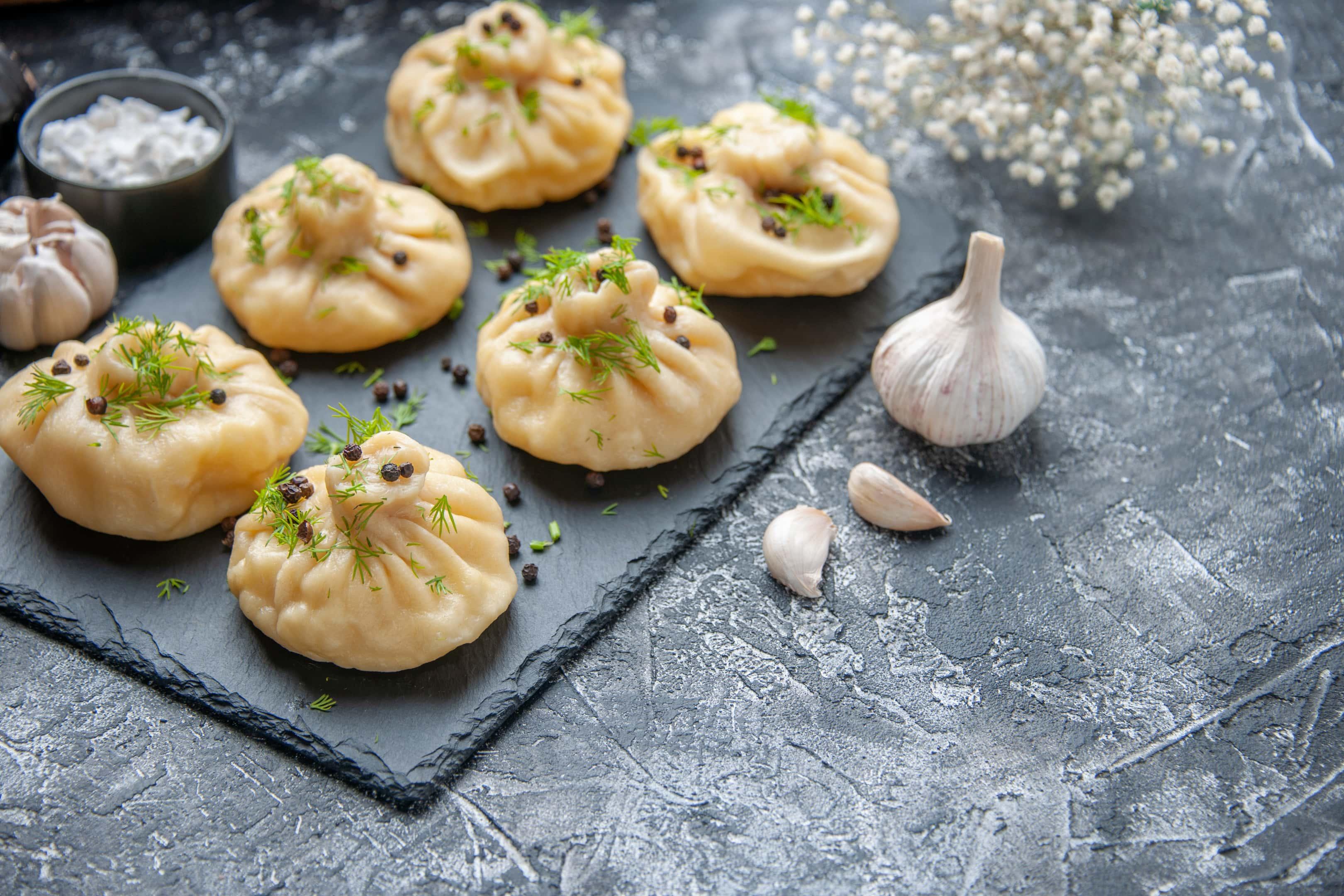 Garlic dumplings on cutting board