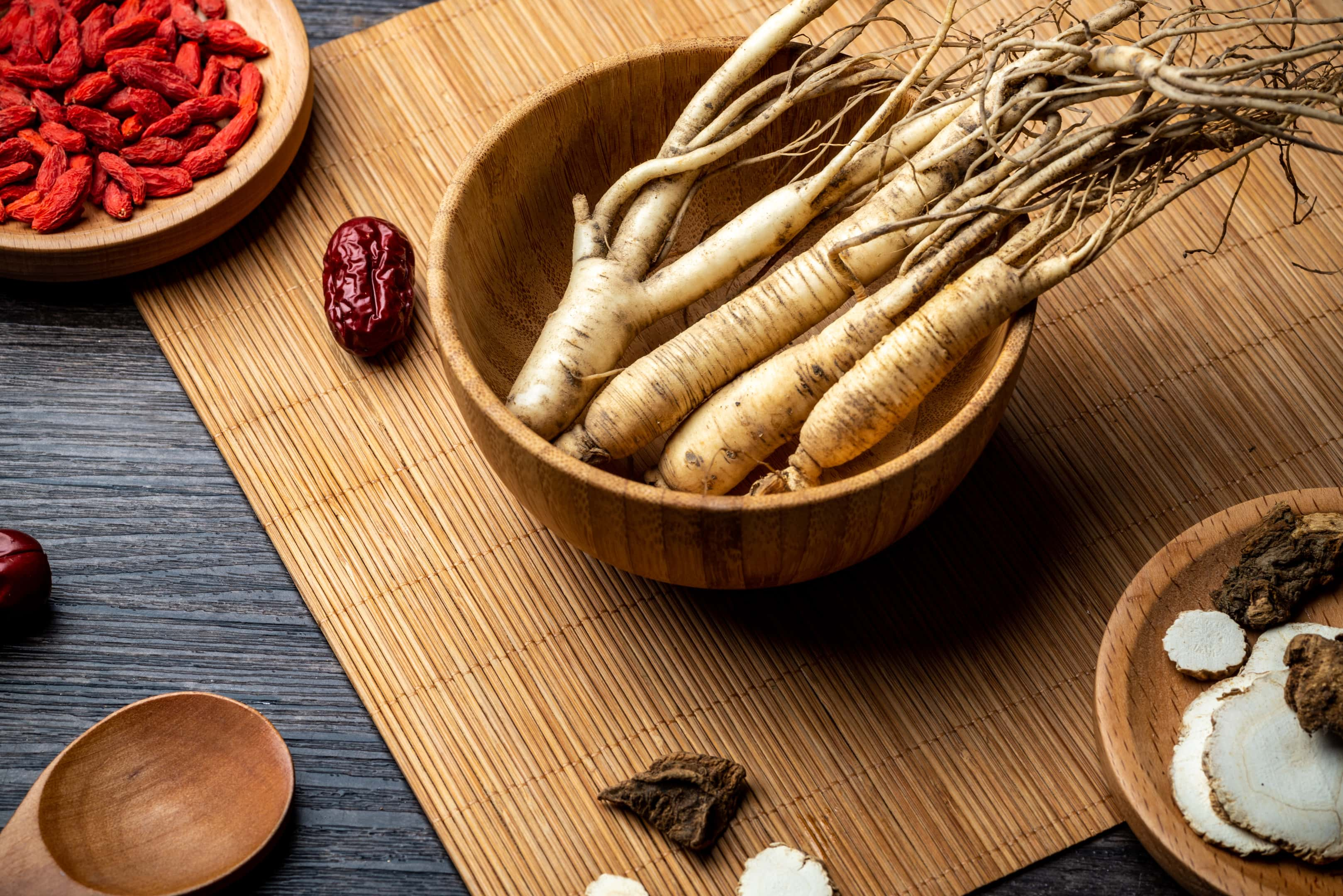 Ginseng wolfberry and jujube in wooden bowl