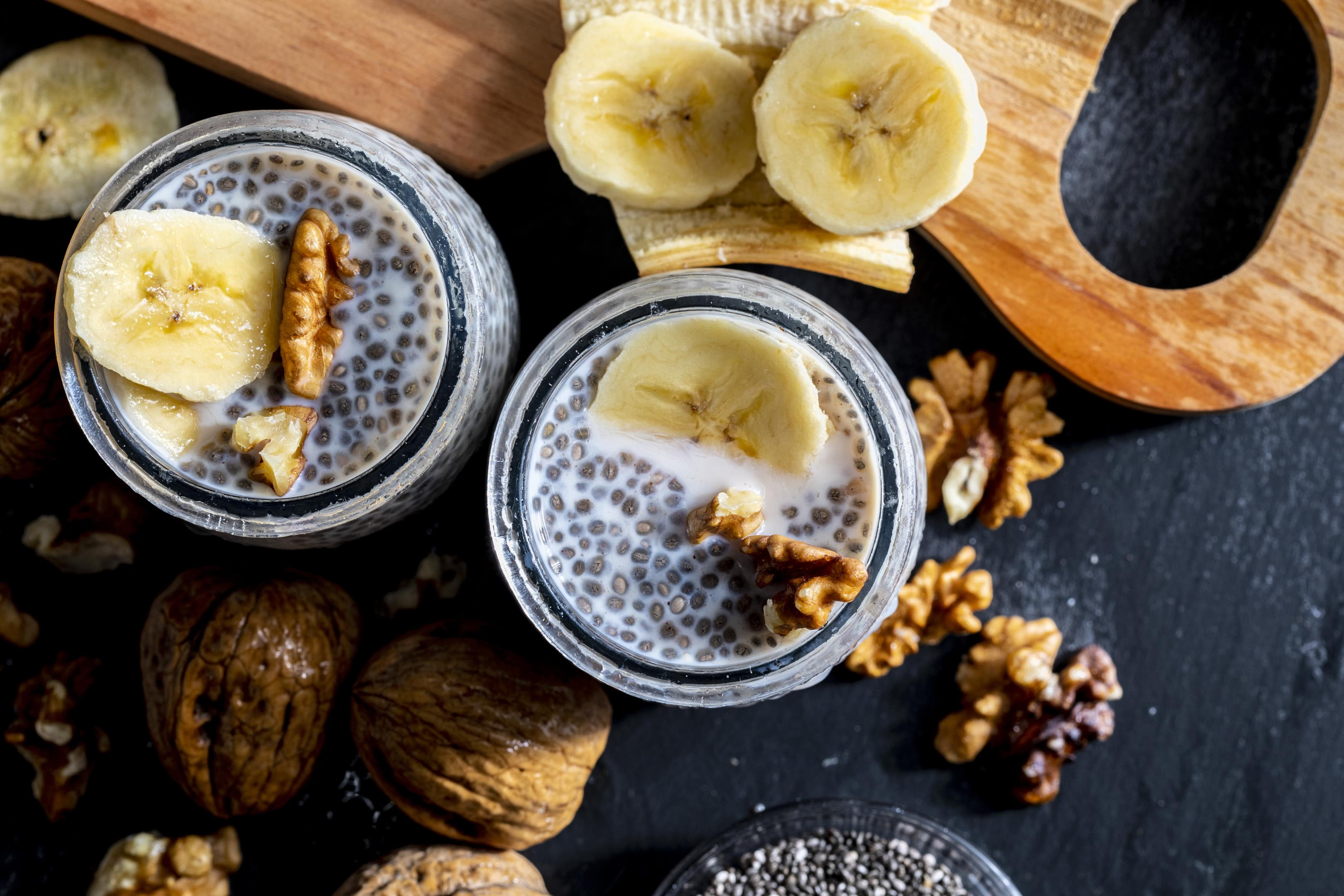 Healthy chia seed pudding with fresh blueberries bananas and walnuts