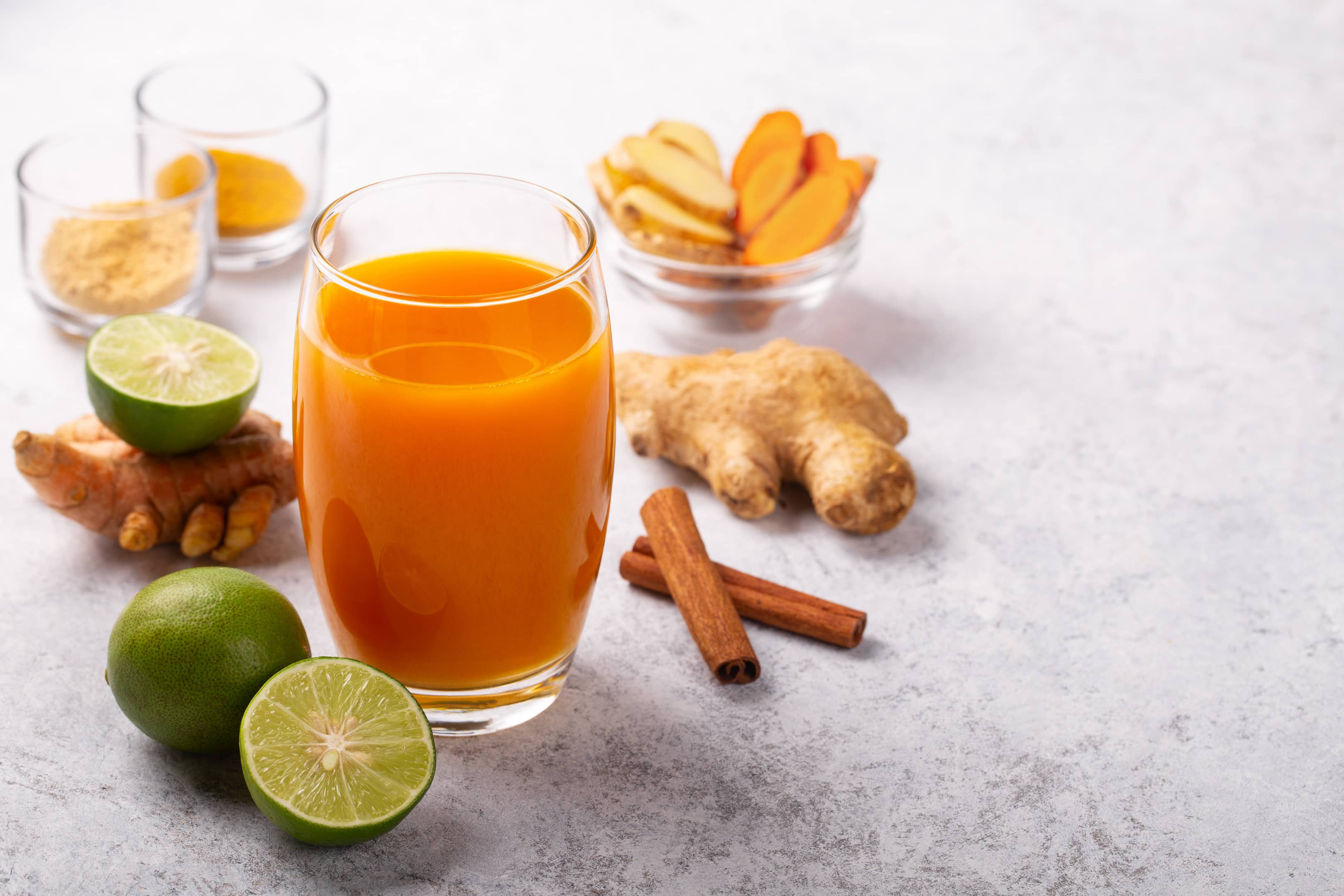 Healthy turmeric tamarind and ginger drink with lime