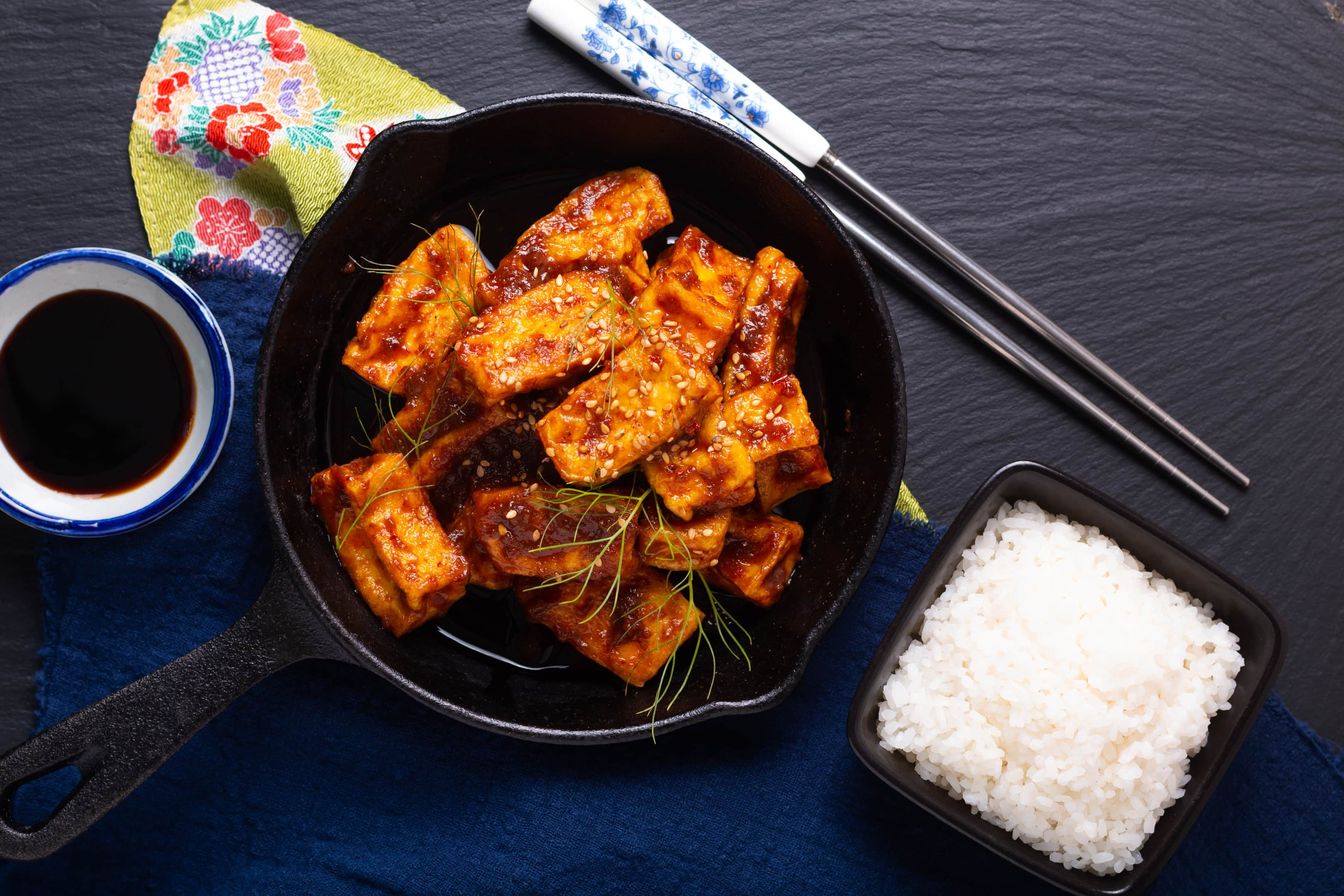 Homemade stir fried tofu with spicy chili sauce served with rice