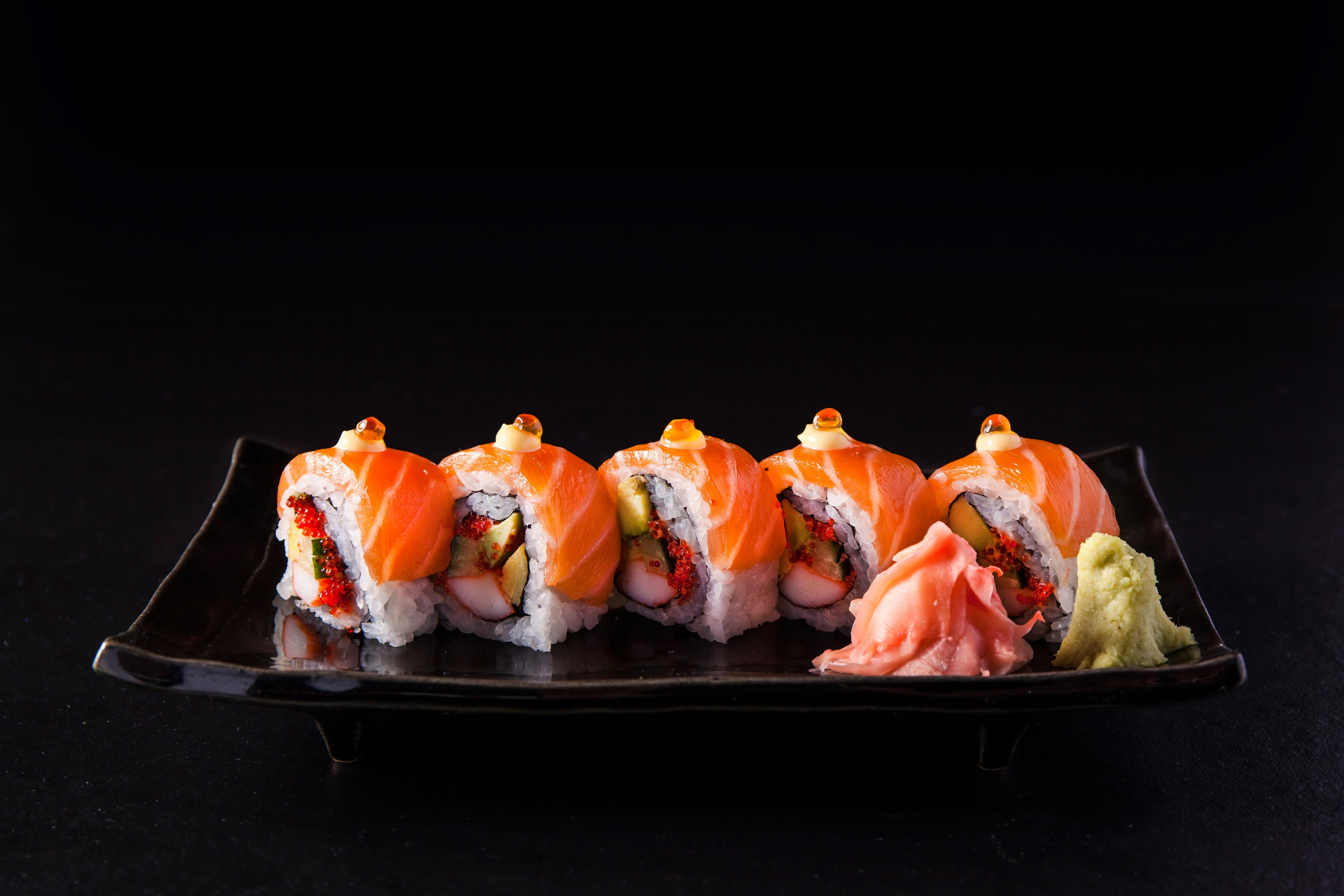 Salmon sushi roll with salmon eggs