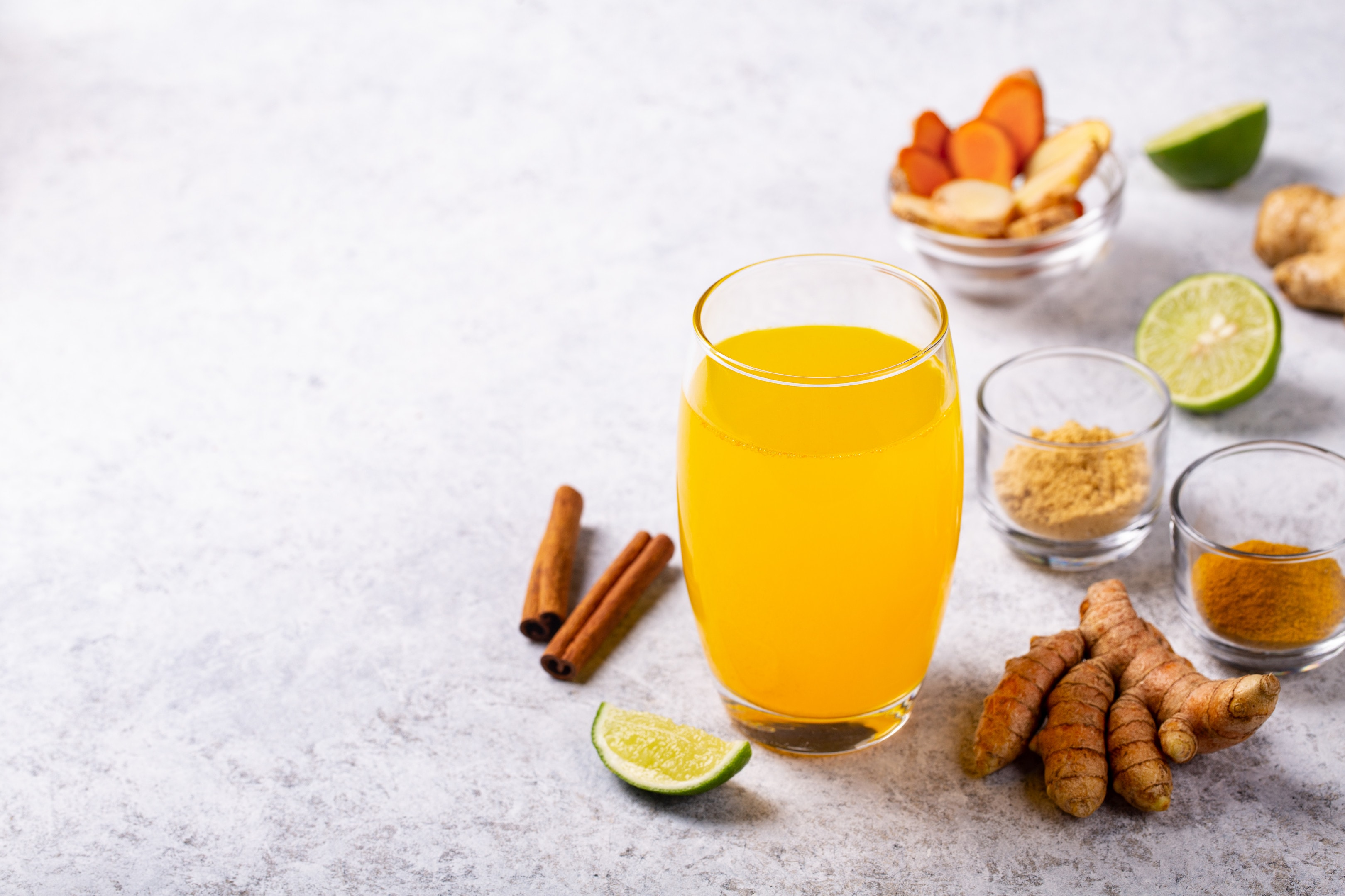 Turmeric tamarind and ginger drink with lime