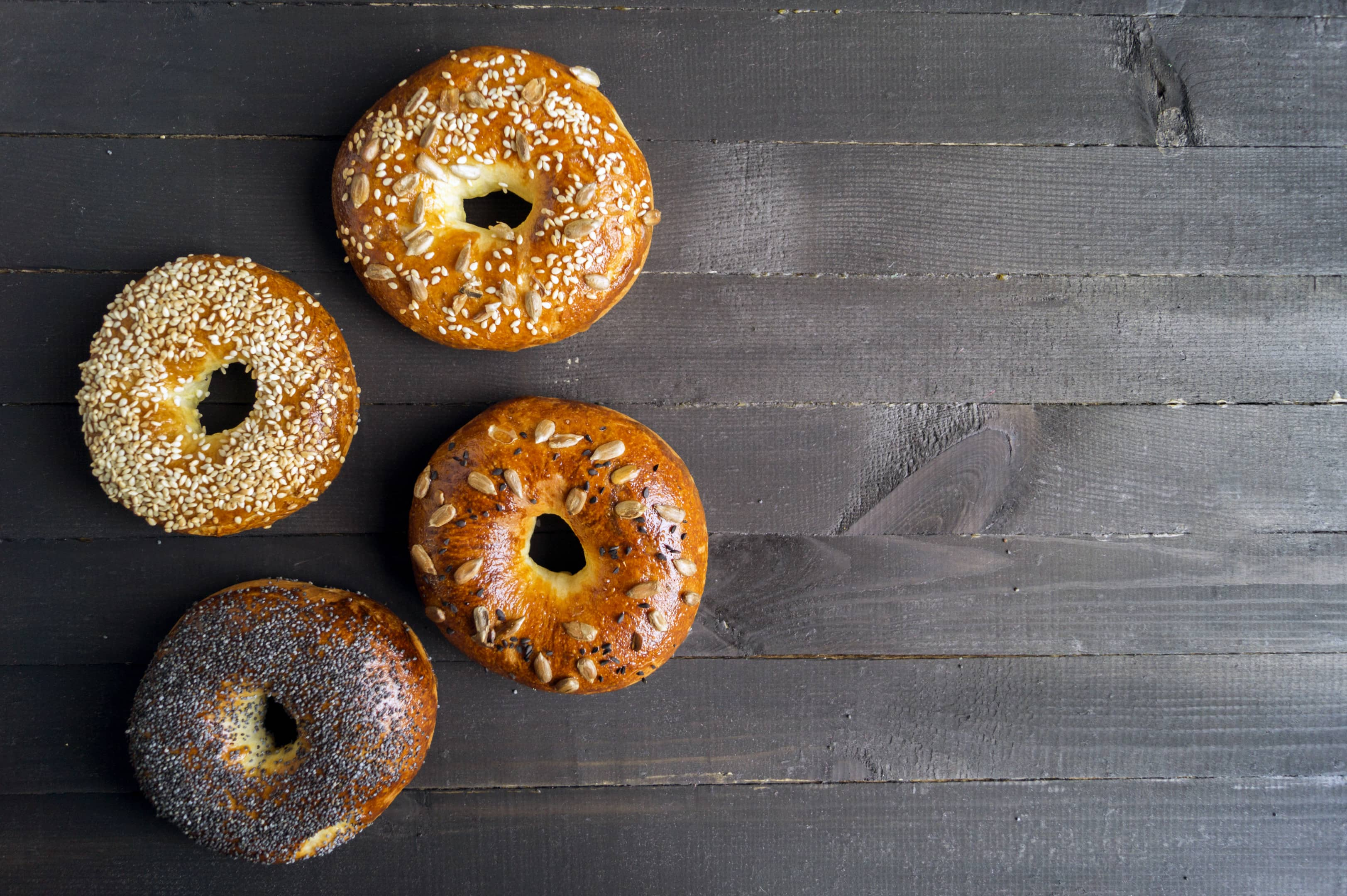 Bagels with seeds on a black table