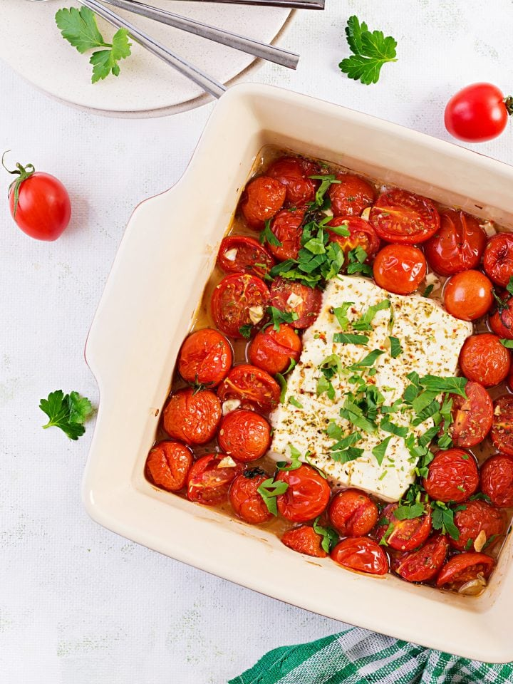 Baked cherry tomatoes, feta cheese, garlic, herbs and olive oil