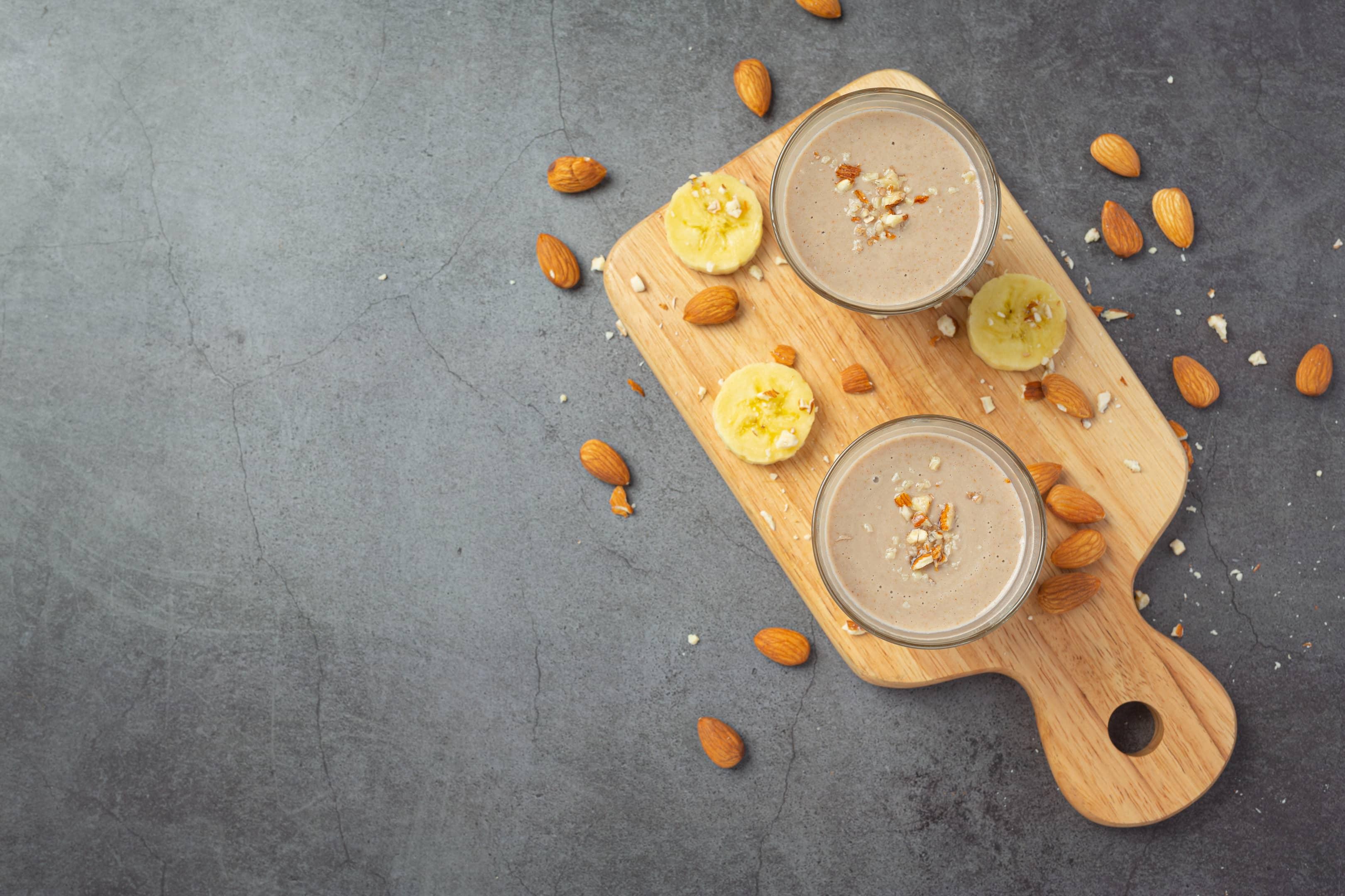 Banana & almond smoothie on dark background