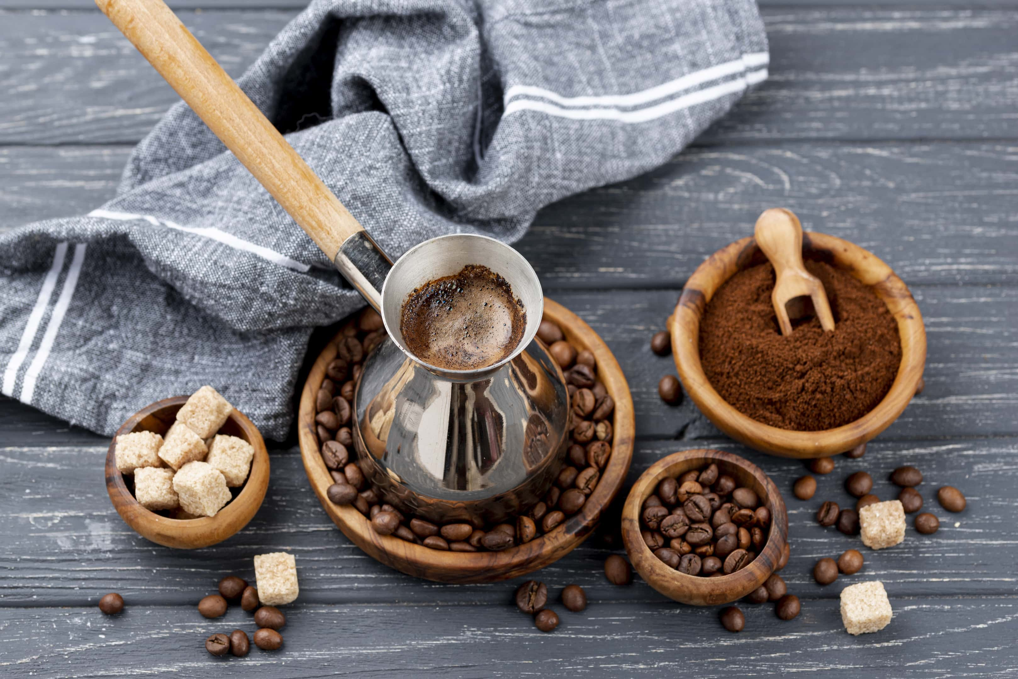 Boiled black coffee with coffee beans