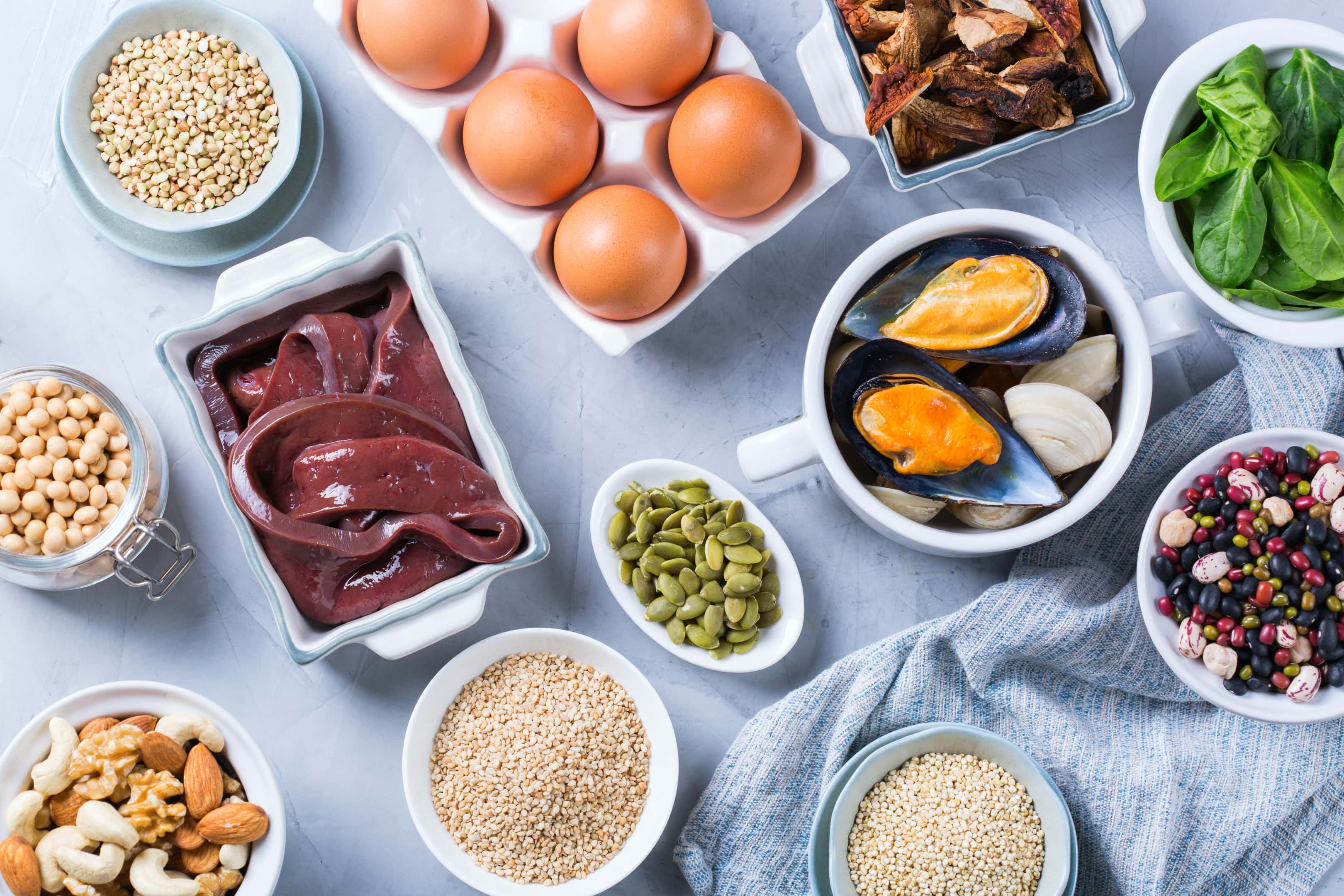 Healthy nutrition — beef liver, spinach, eggs, legumes, nuts, mushrooms, quinoa sesame, pumpkin seeds, soy beans and seafood