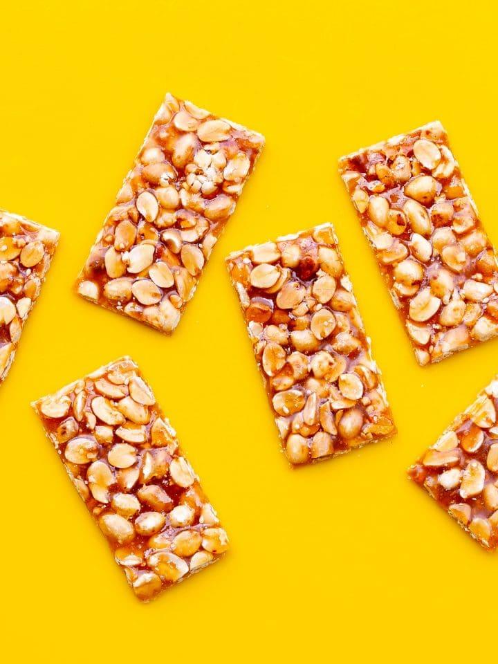 Kadalai mittai — peanuts and jaggery bars on yellow surface