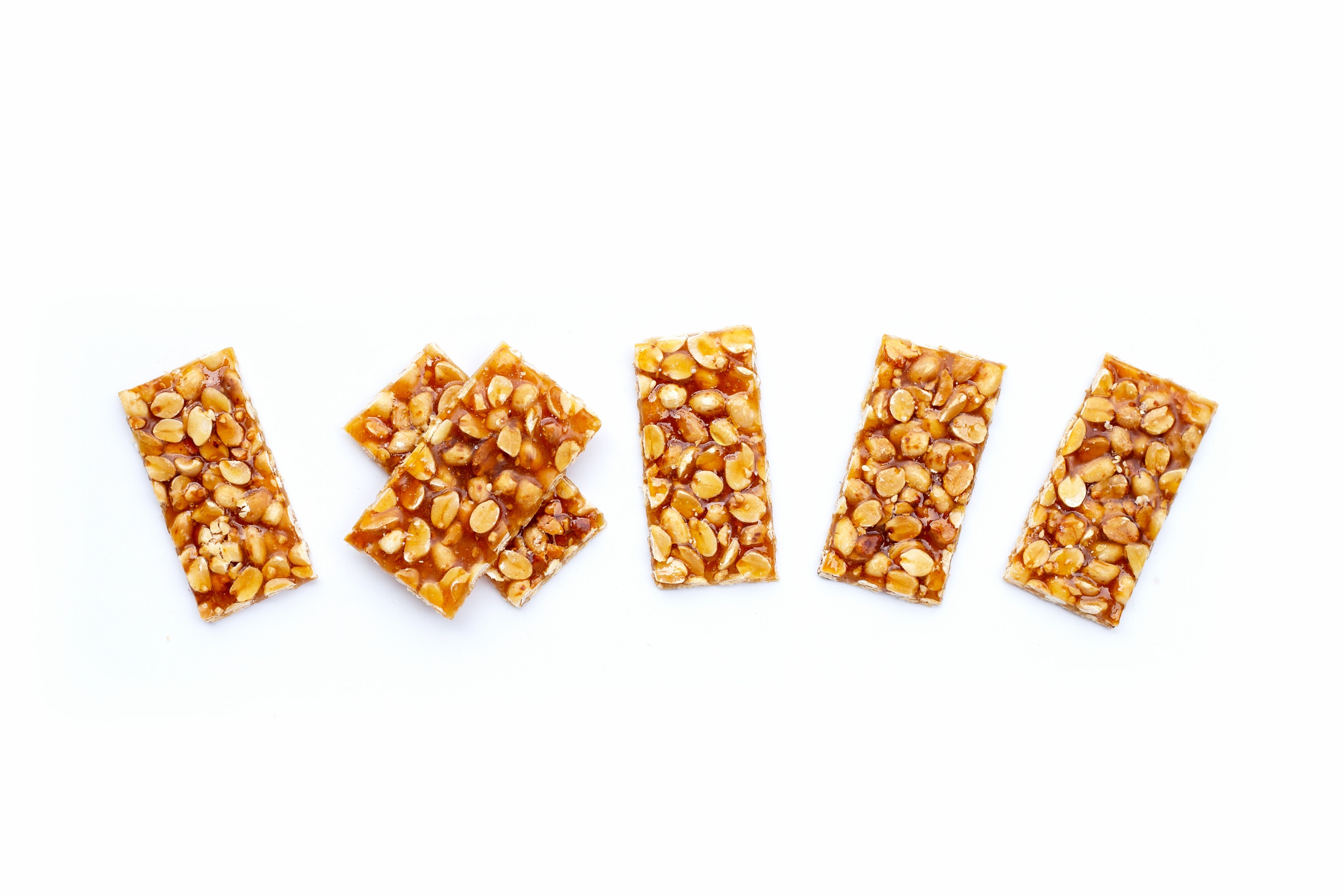 Kadalai mittai — peanuts and jaggery bars on white background