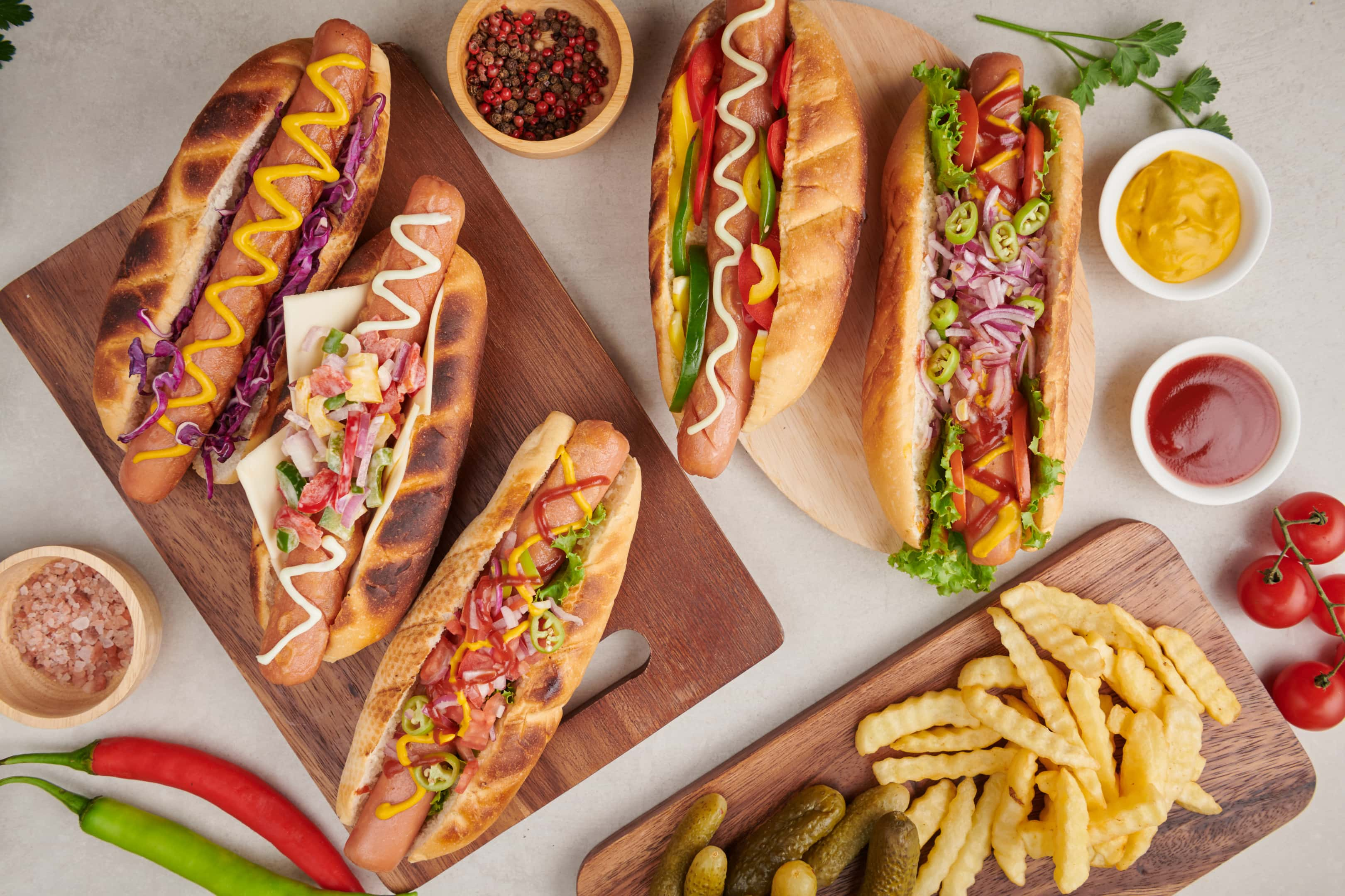 Grilled hot dog sausages with sides chips