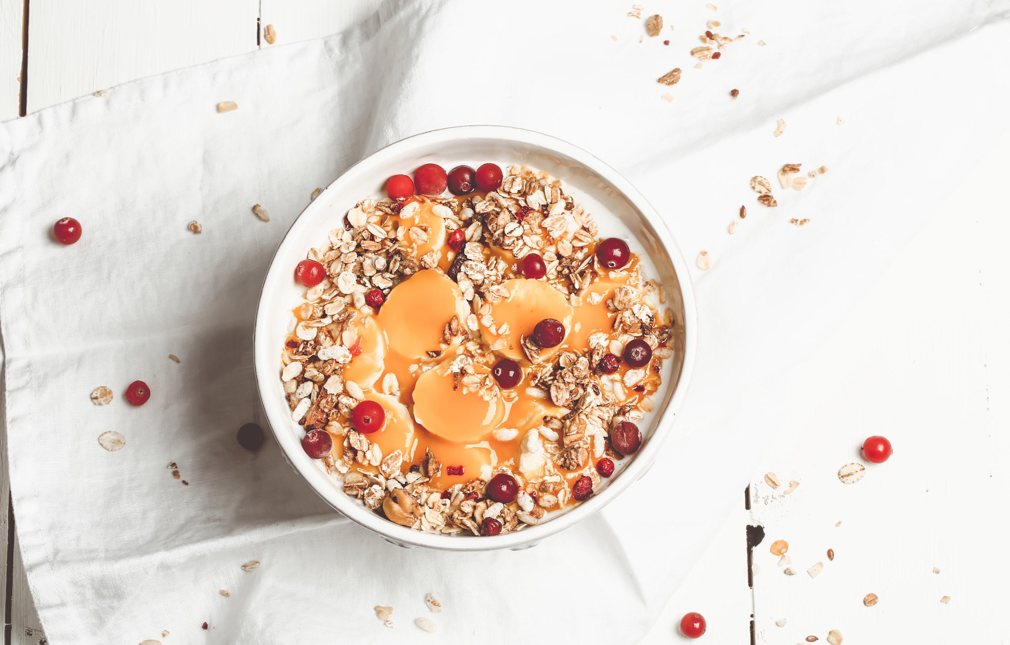 Oatmeal with berries banana and mango
