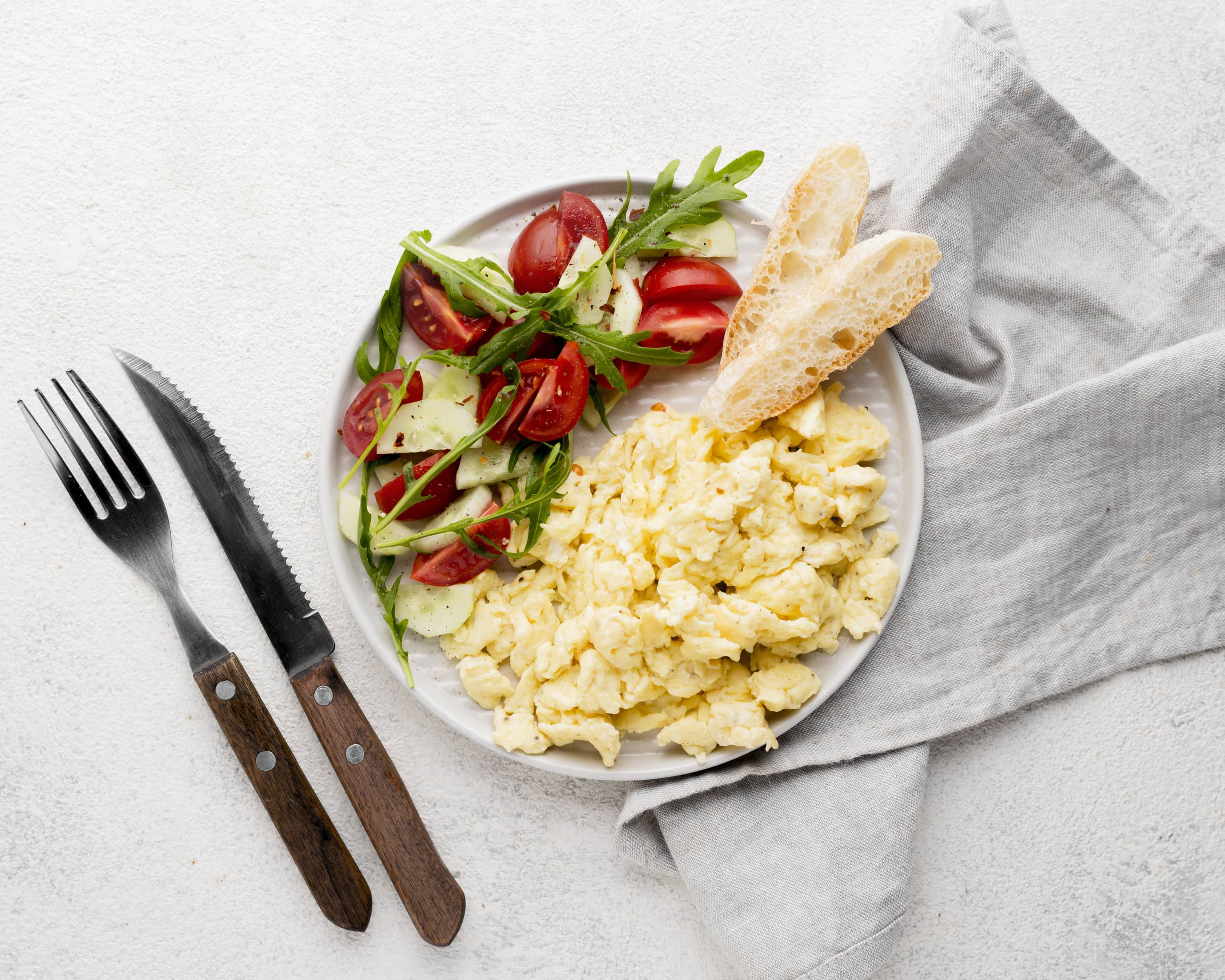 Plate of scrambled eggs and salad