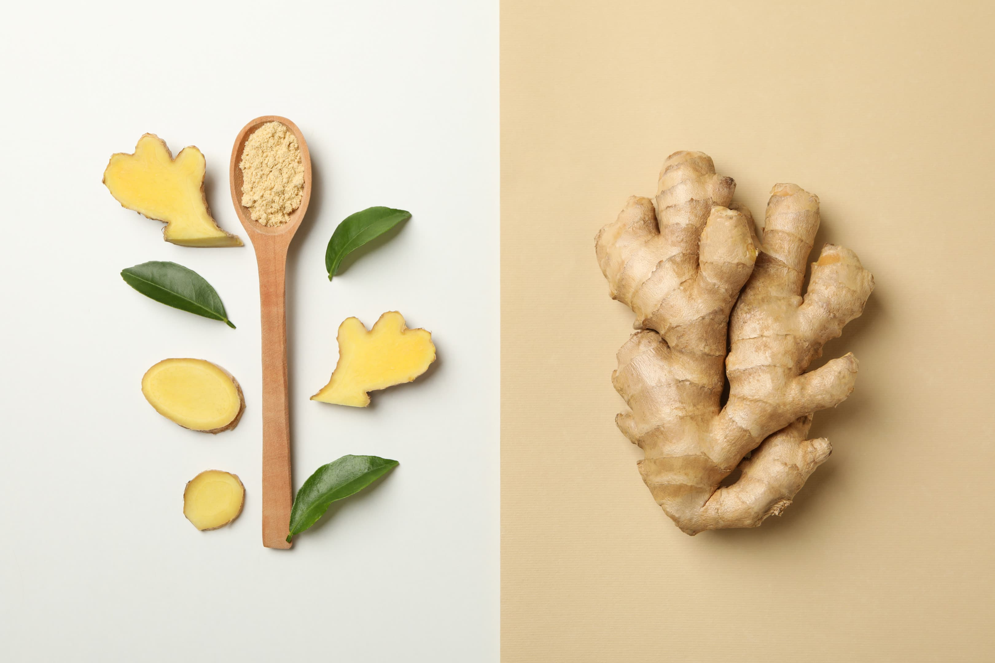 Ginger — spoon with ginger powder and whole ginger root