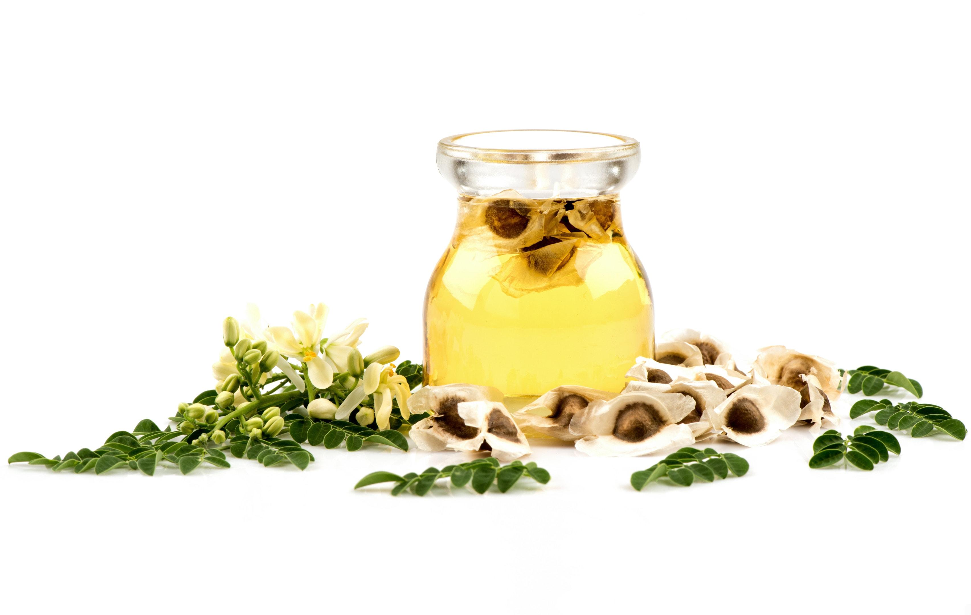 Moringa oil with moringa seeds and leaves