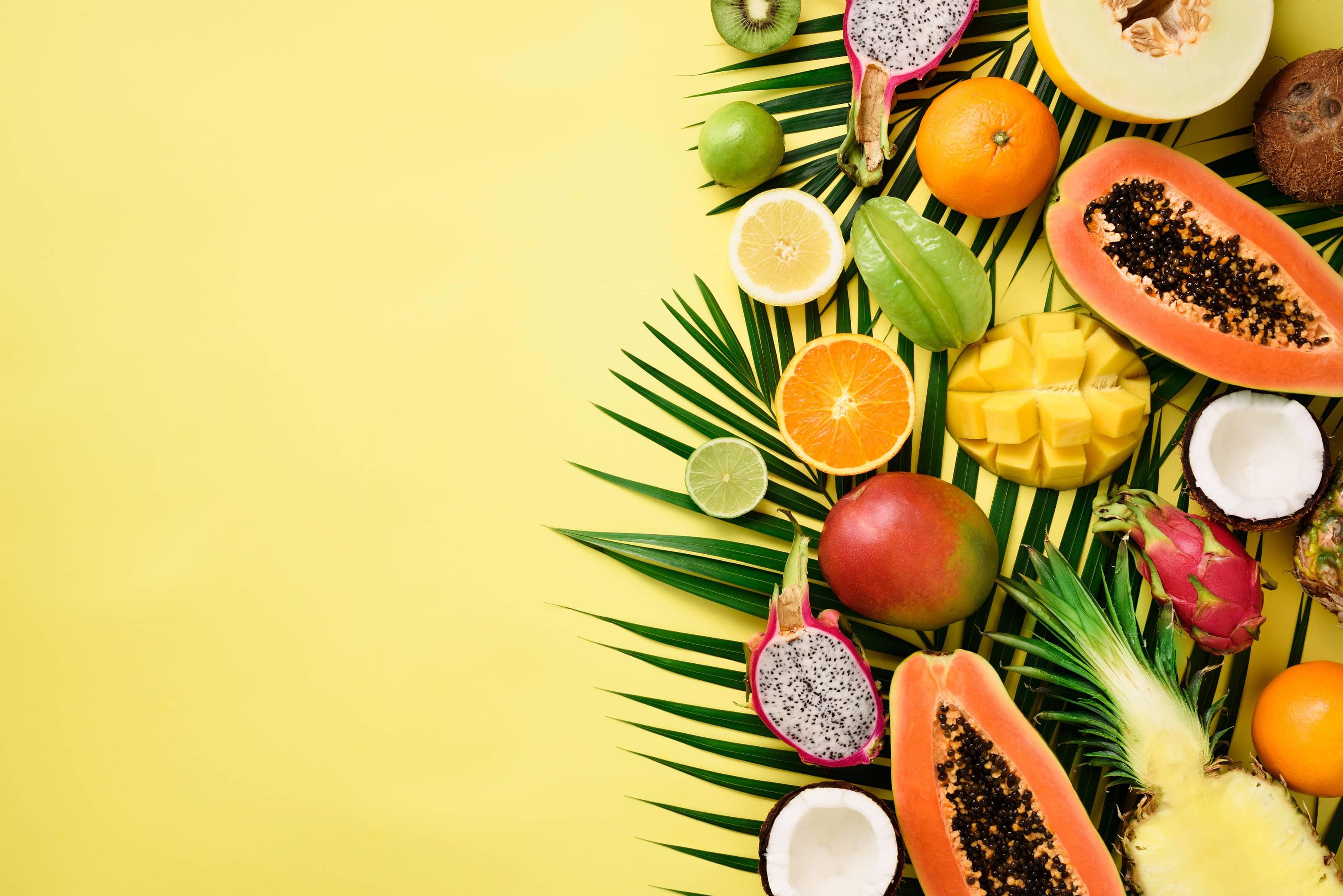 Tropical fruits — papaya, mango, pineapple, carambola, dragon fruit, kiwi, lemon, orange, melon, coconut and lime