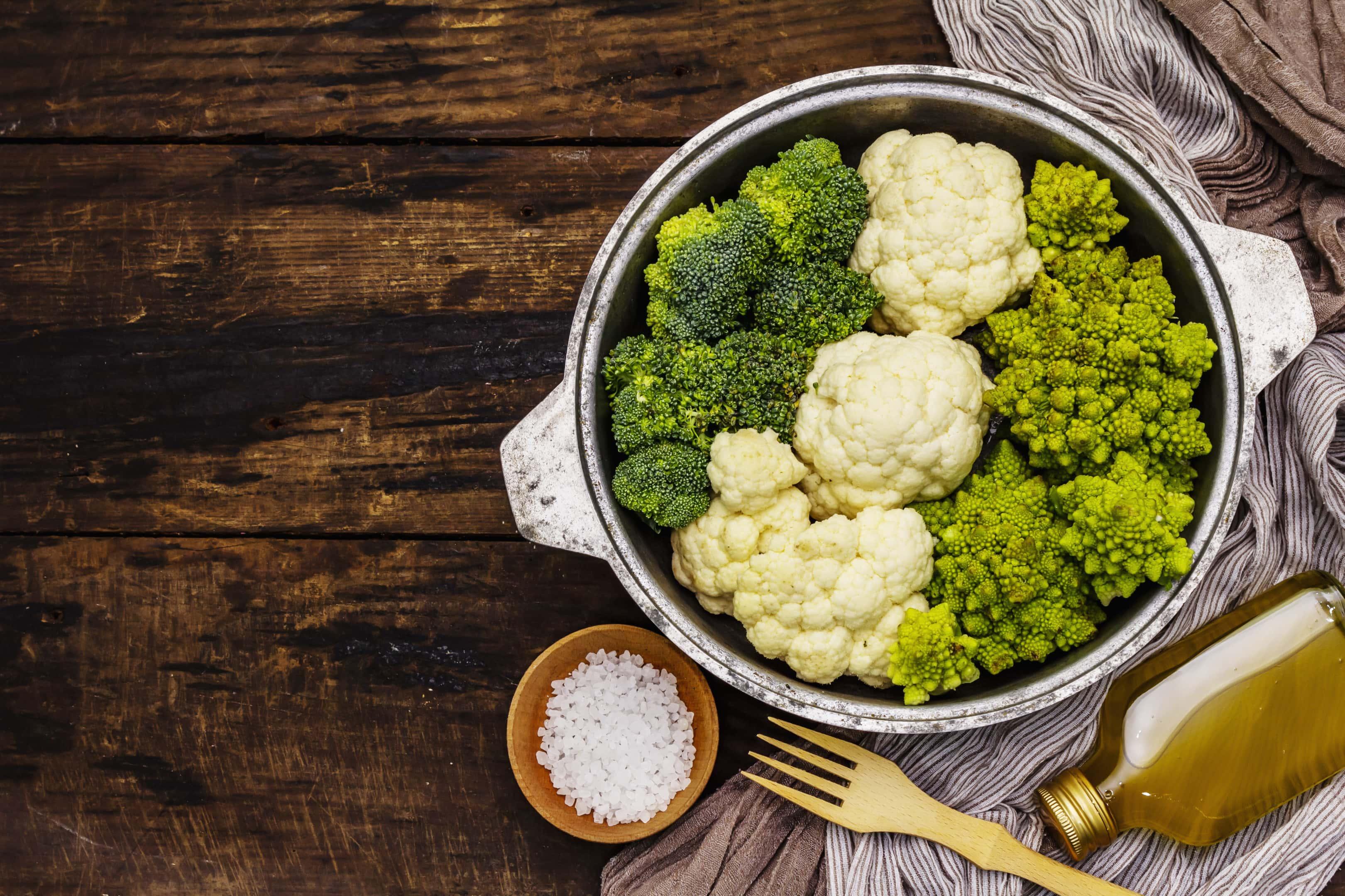 Broccoli, romanesco and cauliflower in a pen