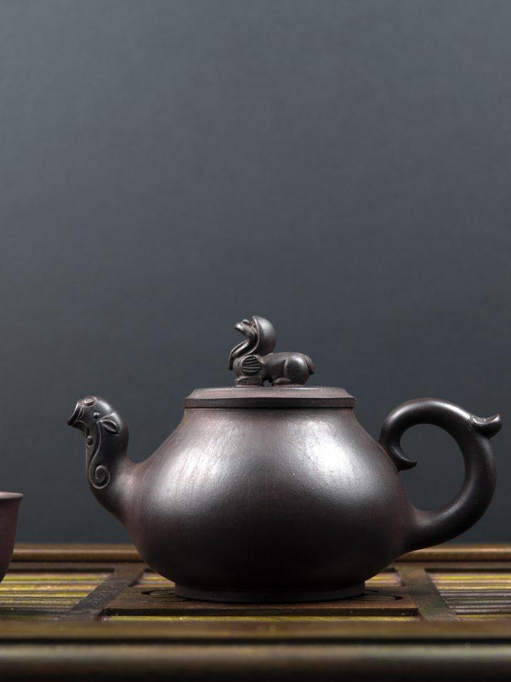 Ancient teapot with black soybean tea
